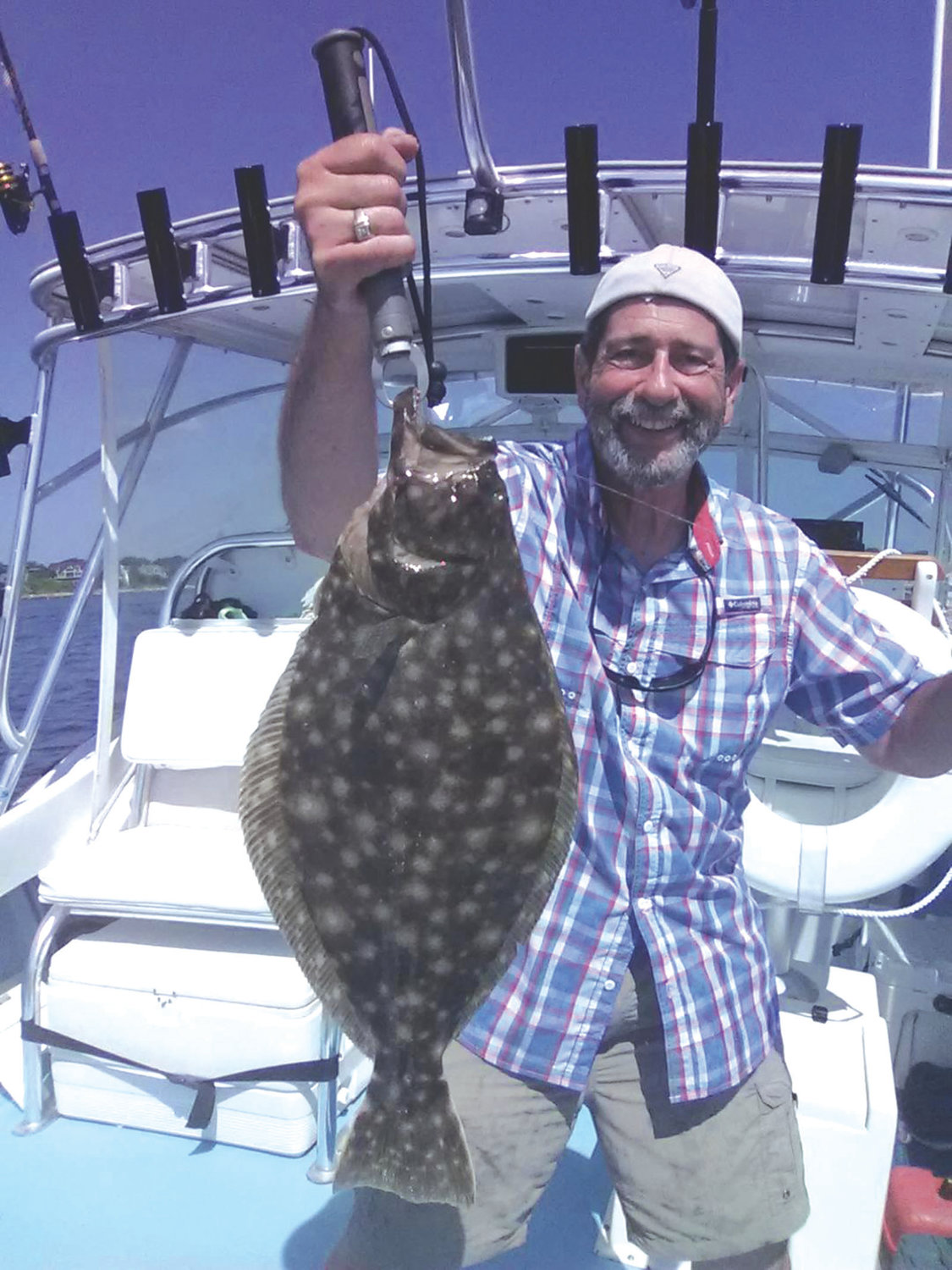 "WHAT'S THE CATCH: Capt. Dave Monti with a summer flounder caught off Jamestown this summer. Scientists say ""slot limits could have negative impacts on the summer flounder stock, especially under current conditions."" (Submitted photo)"