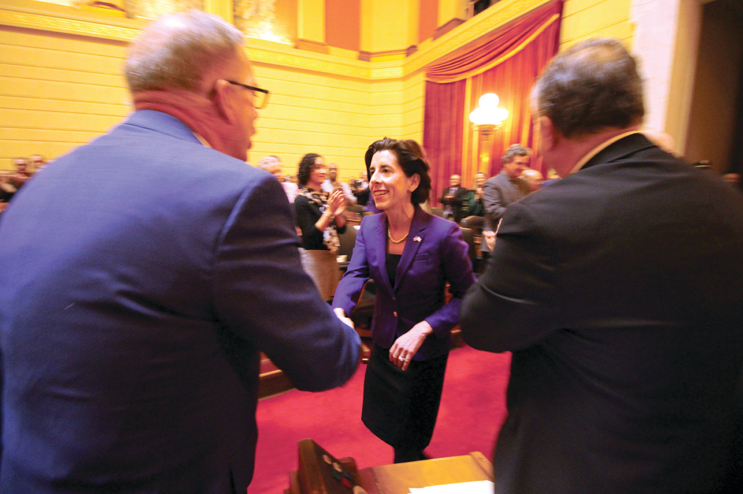 WELCOME: Warwick Rep. Joseph McNamara and fellow legislators greeted state department directors as they entered the chambers Tuesday for the governor's State of the State address. Here McNamara shakes hands with Governor Gina Raimondo.
