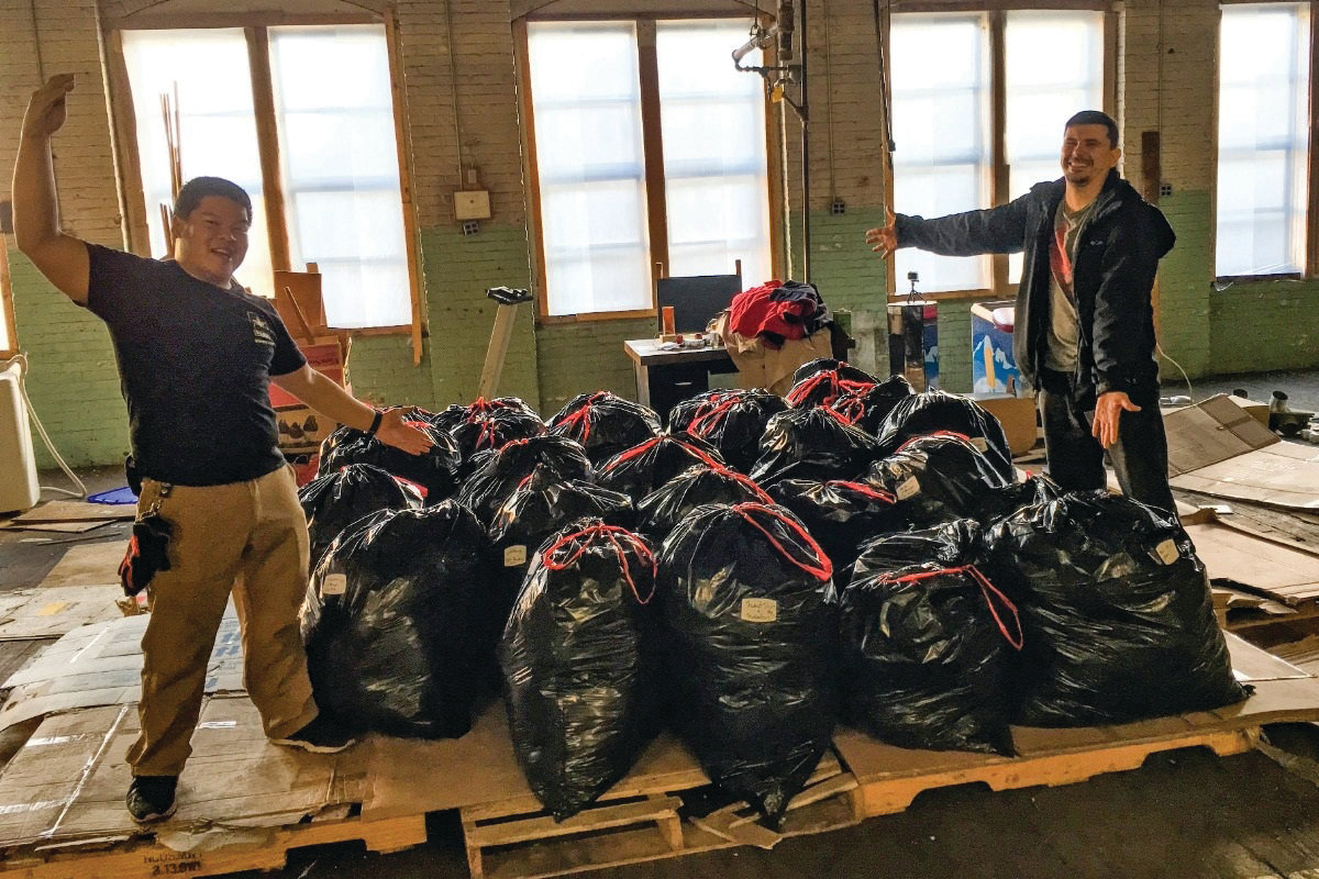 QUITE A HAUL: Nathan Quattrini with the nearly 50 bags of clothes found during a movie shoot that he looks to donate to the needy.