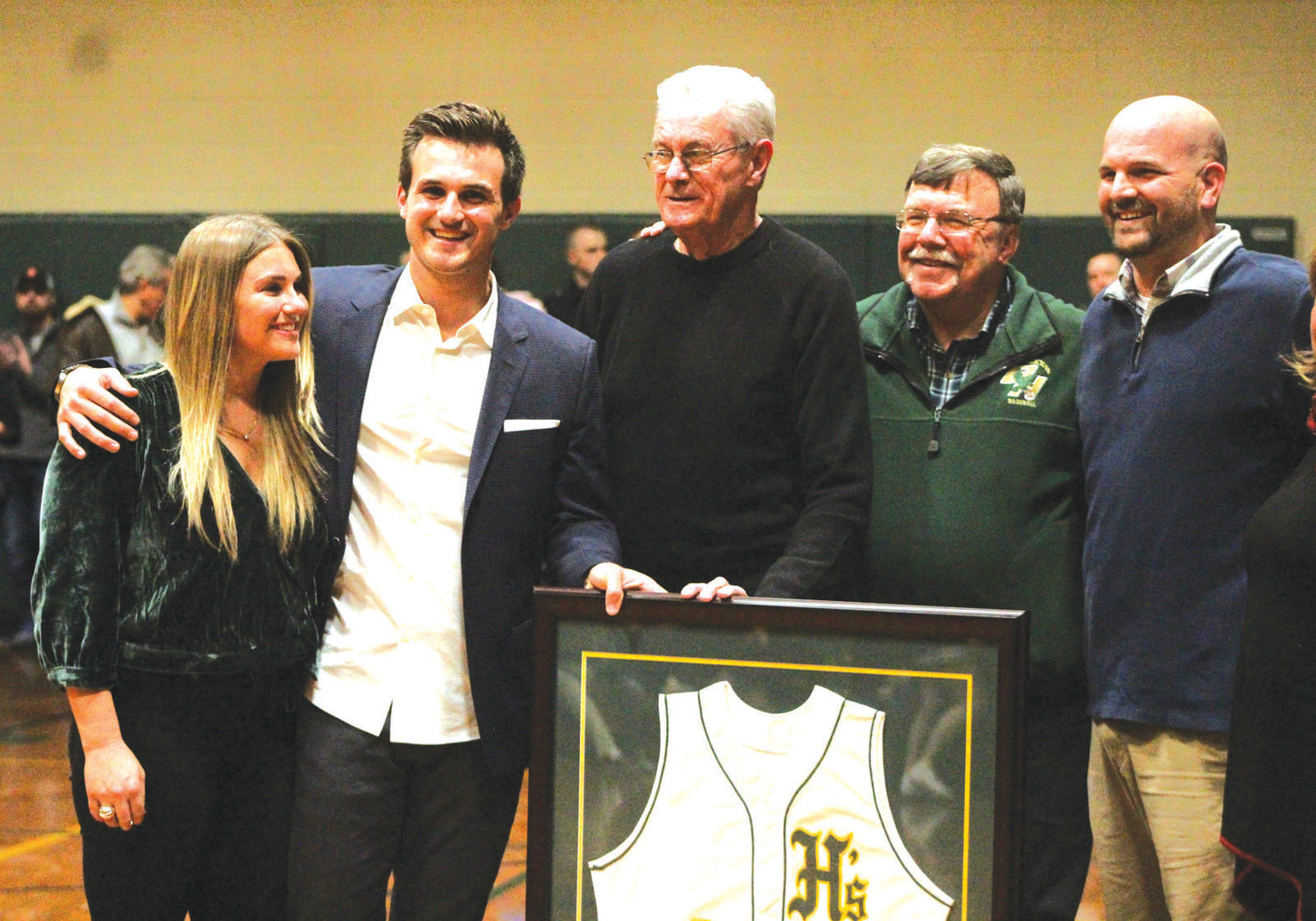 MAN OF HONOR: Thomas Pannone (second from left) is joined by the Hendricken community to retire his jersey.