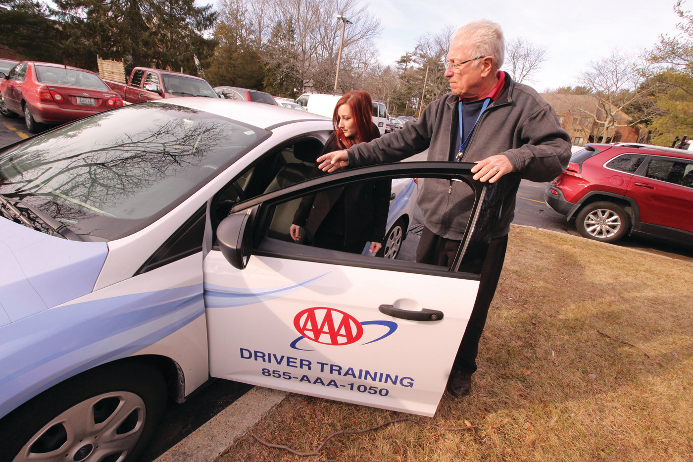 AN INTRODUCTION: Driving trainer Stephen Fenton goes over features of a vehicle before he and Kayla Broadmeadow get in.
