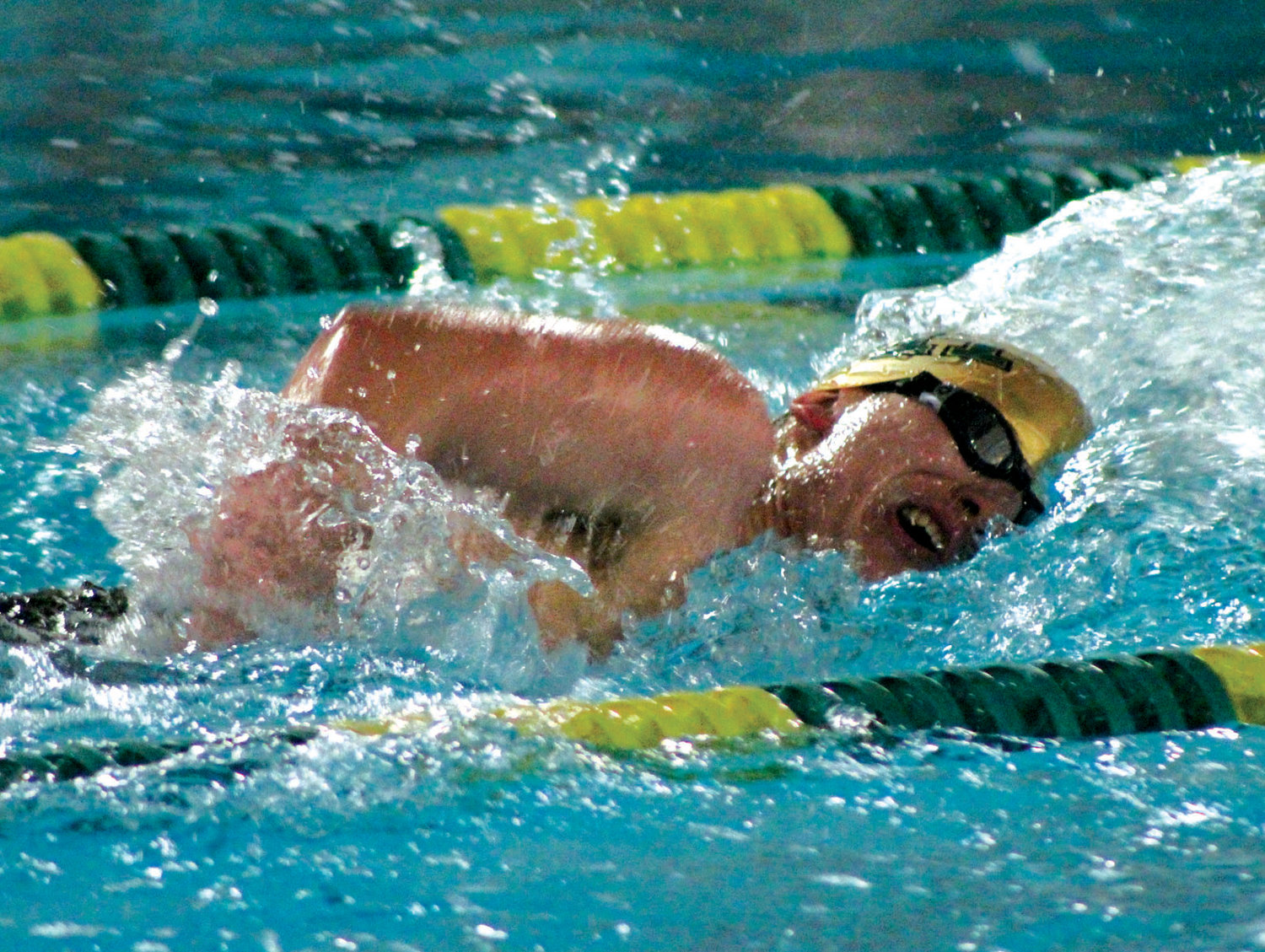 IN THE POOL: A Bishop Hendricken swimmer competes in a relay.