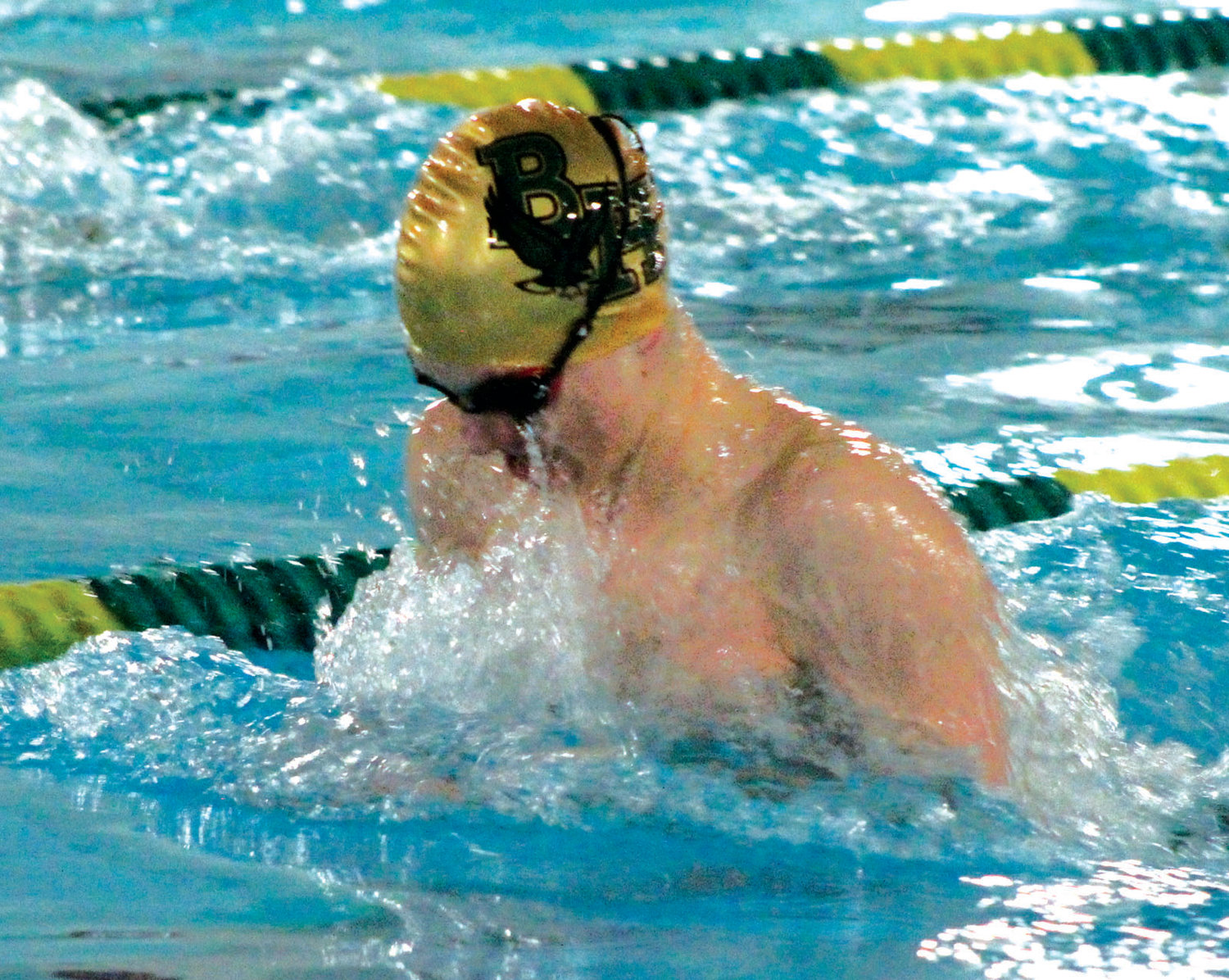 MAKING A SPLASH: Hendricken's Grant Dator competes in the breaststroke.