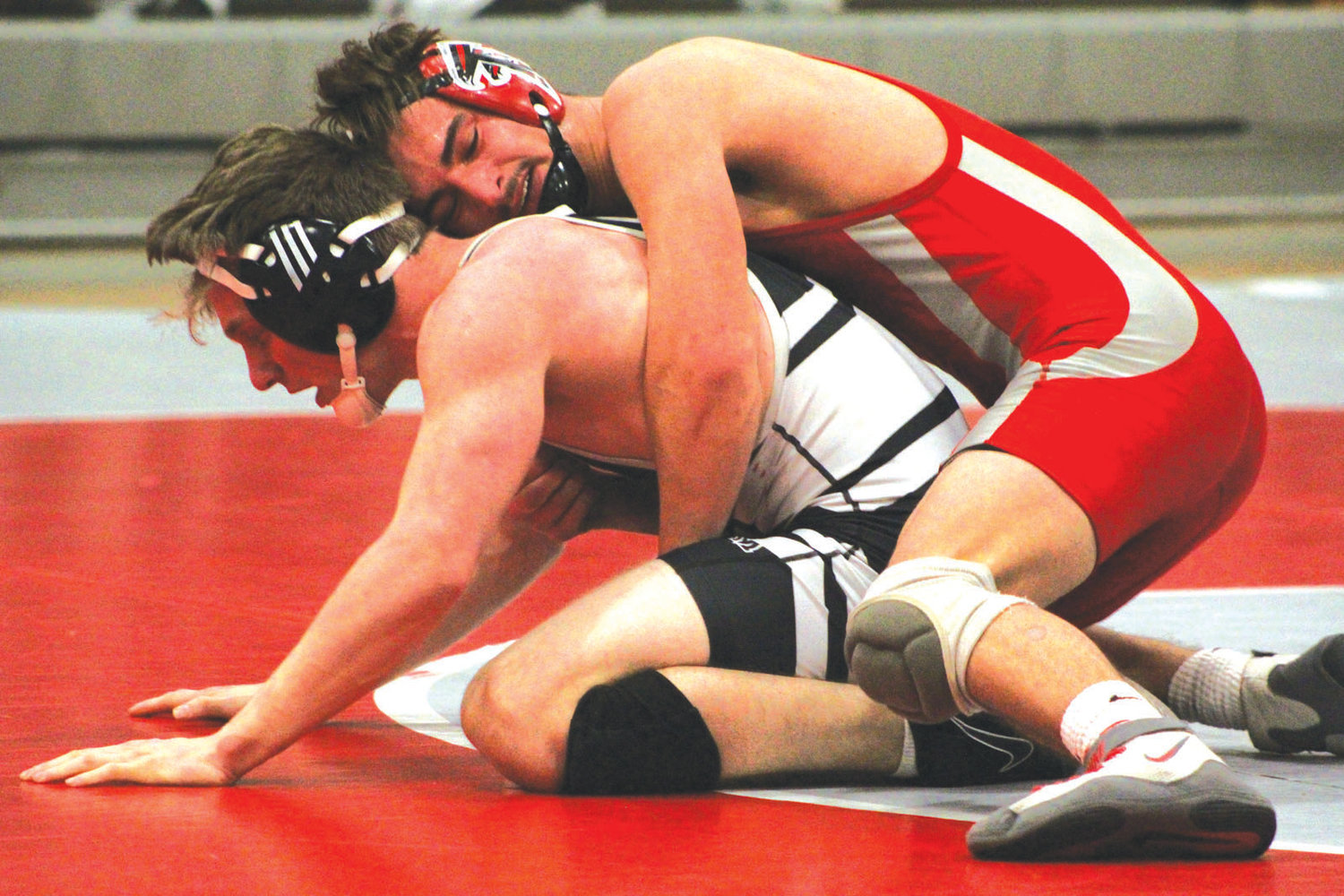TAKING THE BACK: Cranston West's Nelson Cooper takes the back of a Pilgrim grappler.