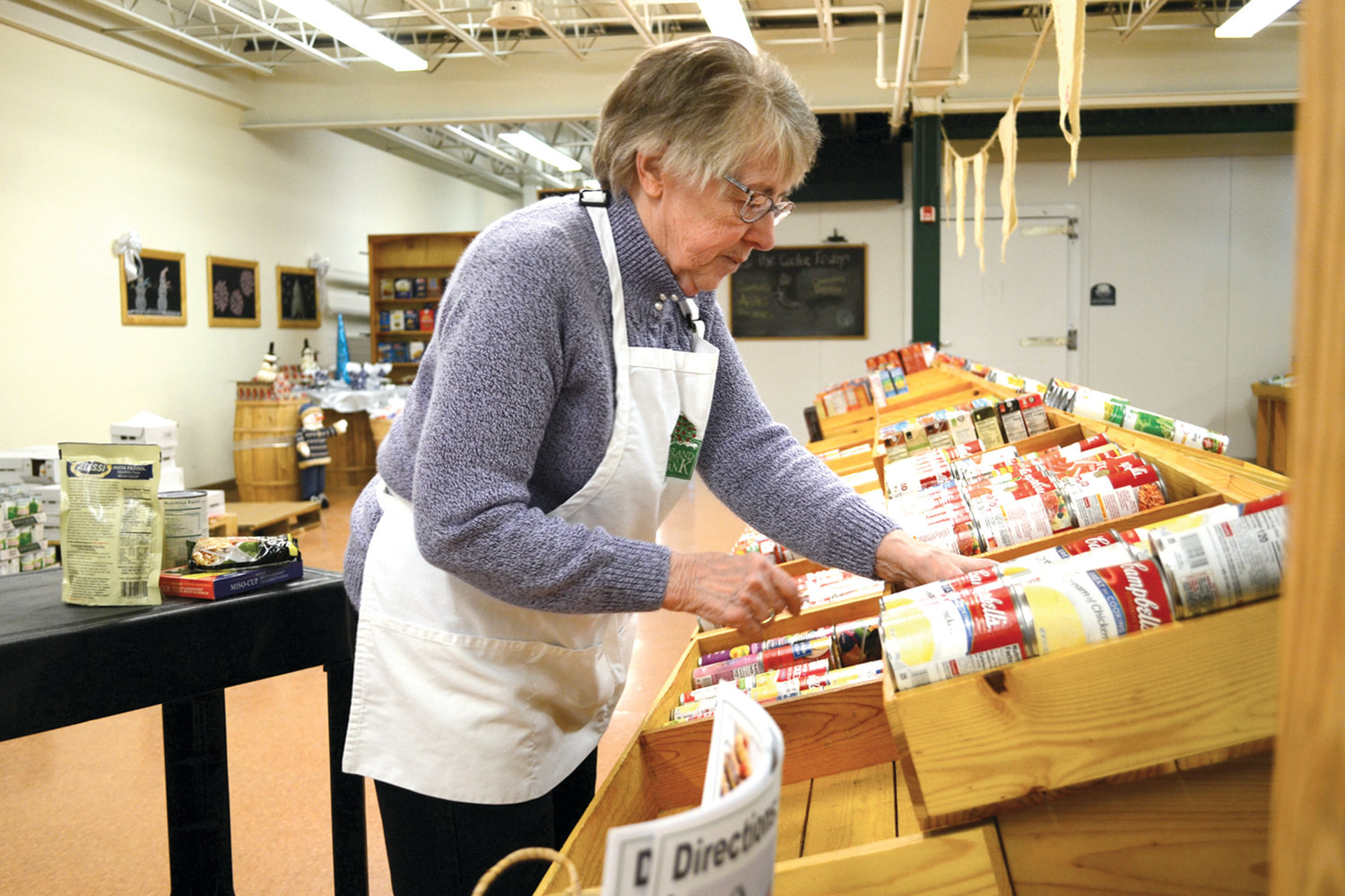 OTHER WAYS TO HELP: Some people donate food or money, but others, like Warwick resident Judy Marshall, donate their time as volunteers. Marshall has been helping out at the Rhode Island Community Food bank since 2005.