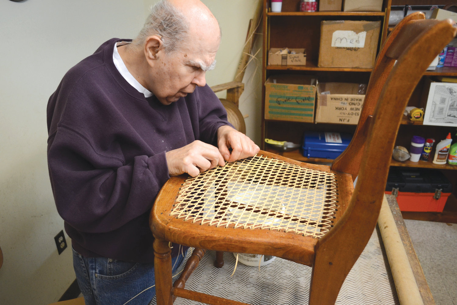 MASTER CRAFTSMAN: Ray Pontbriant works on caning a chair in the INSIGHT workshop. This will be the final year for such intricate work at the facility, as the caning shop is closing down in December.
