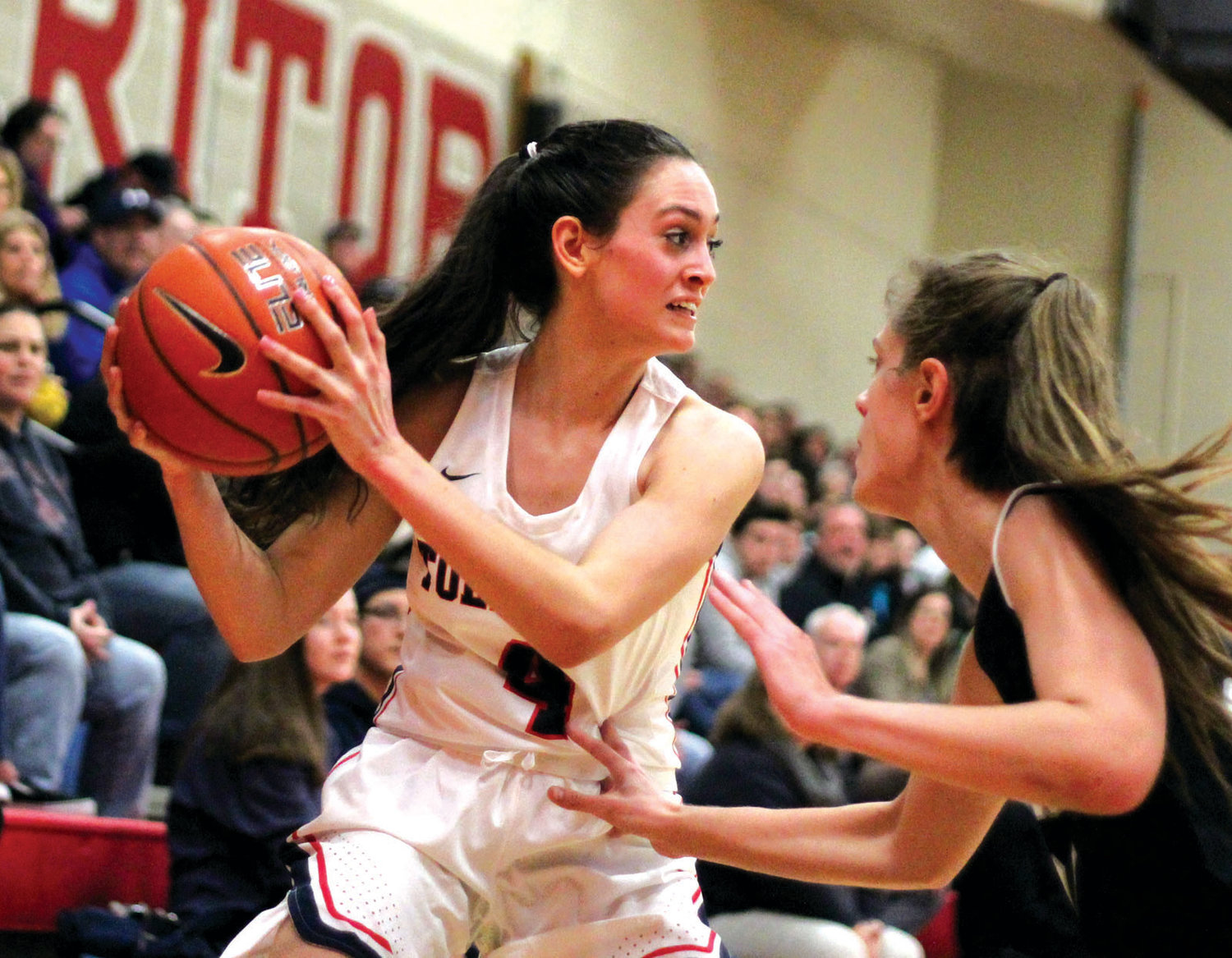 CITY RIVALS: Toll Gate's Natalie Aloisio works past a Pilgrim defender on Monday evening at Toll Gate High School.  The Lady Titans pulled off the upset in the 41-28 win, handing their city rival Patriots their first league loss of the season.