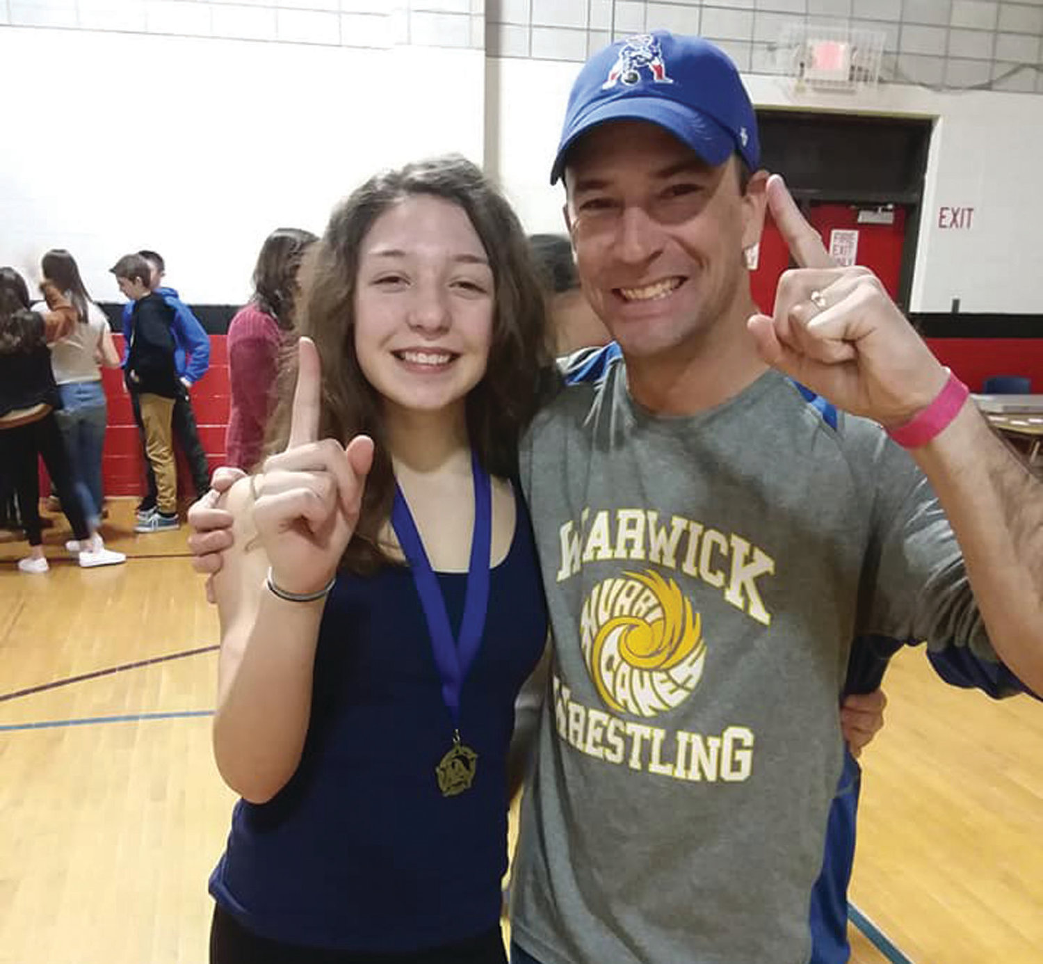 TAKING GOLD: Warwick Vets wrestler Madison Volpe celebrates her junior varsity middle school state championship win with Hurricanes coach Kurt Keaney last weekend.