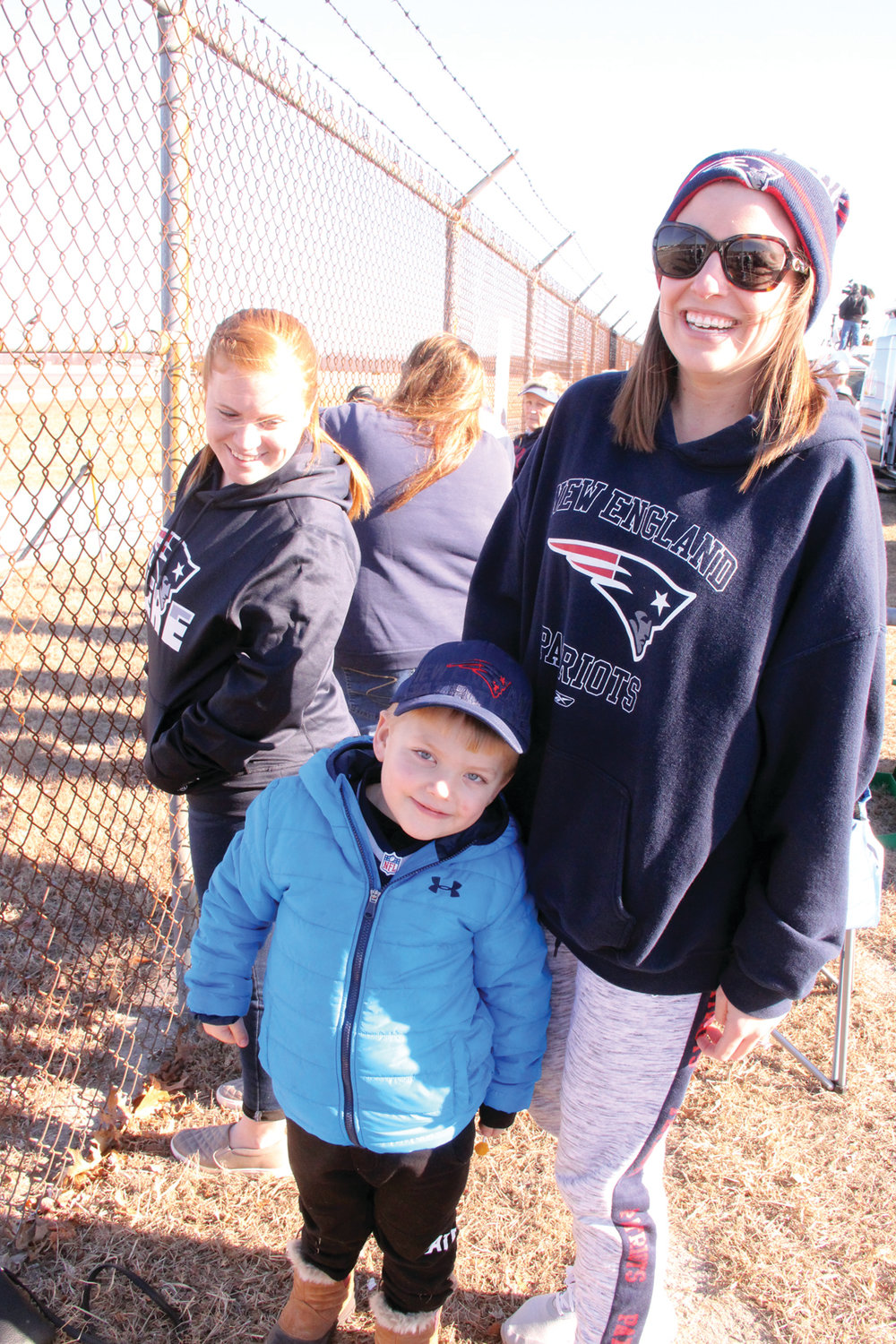 YOUNGEST FAN:  Brayden Milulko and his mother Tricia found a great vantage to greet the Patriots as they arrived at Green Airport Monday.