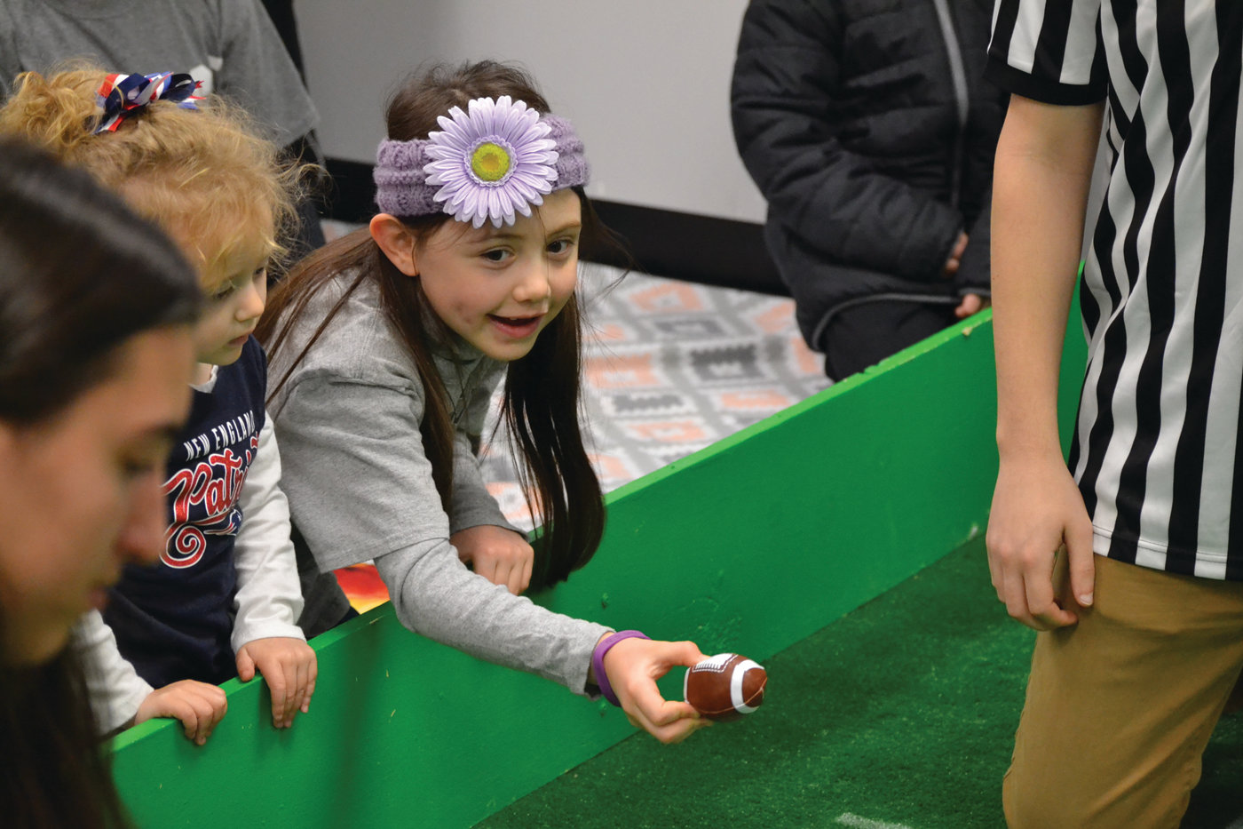HANDOFF: Lydia Cousineau was one of a few lucky children that got a front row seat to the adorable action for the second annual Puppy Bowl. (Warwick Beacon photos)