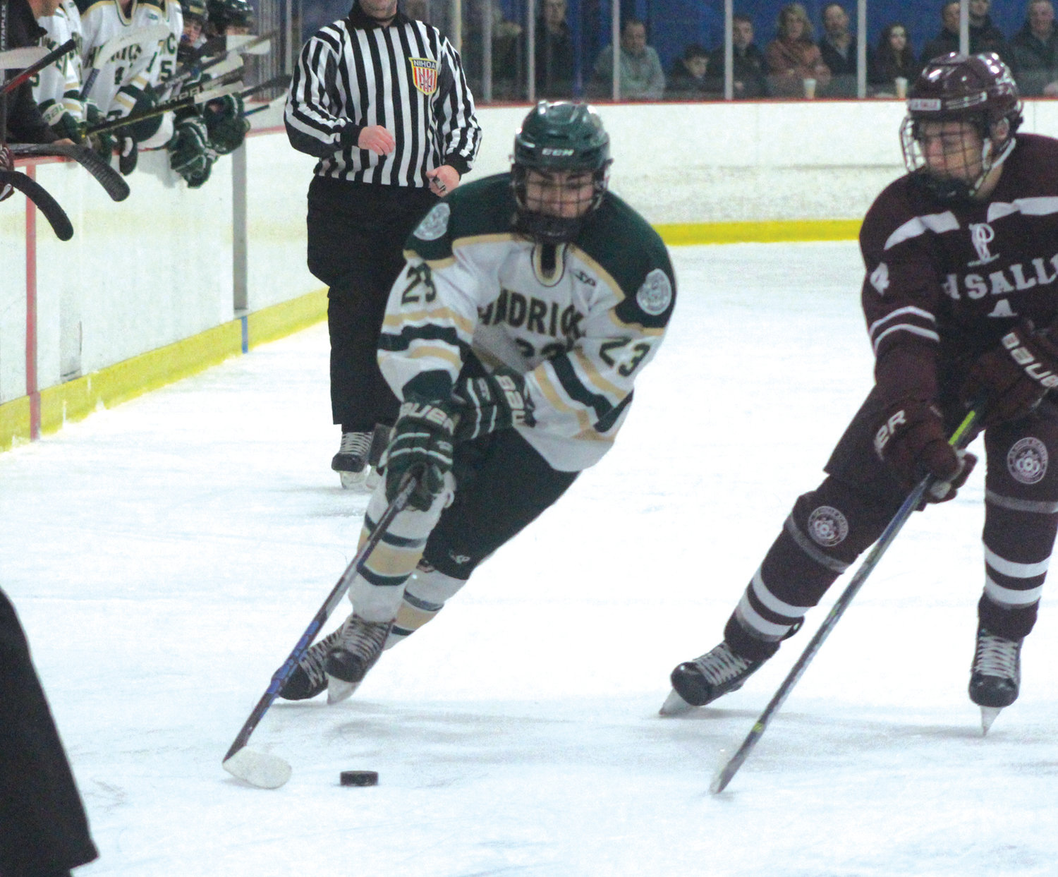 CARRYING THE PUCK: Bishop Hendricken's Matthew Dumond works his way past a La Salle defender last week during the teams' matchup at the Thayer Arena in Warwick. The two clubs would battle to a 4-4 tie on the night, and are likely to square off again in the postseason.