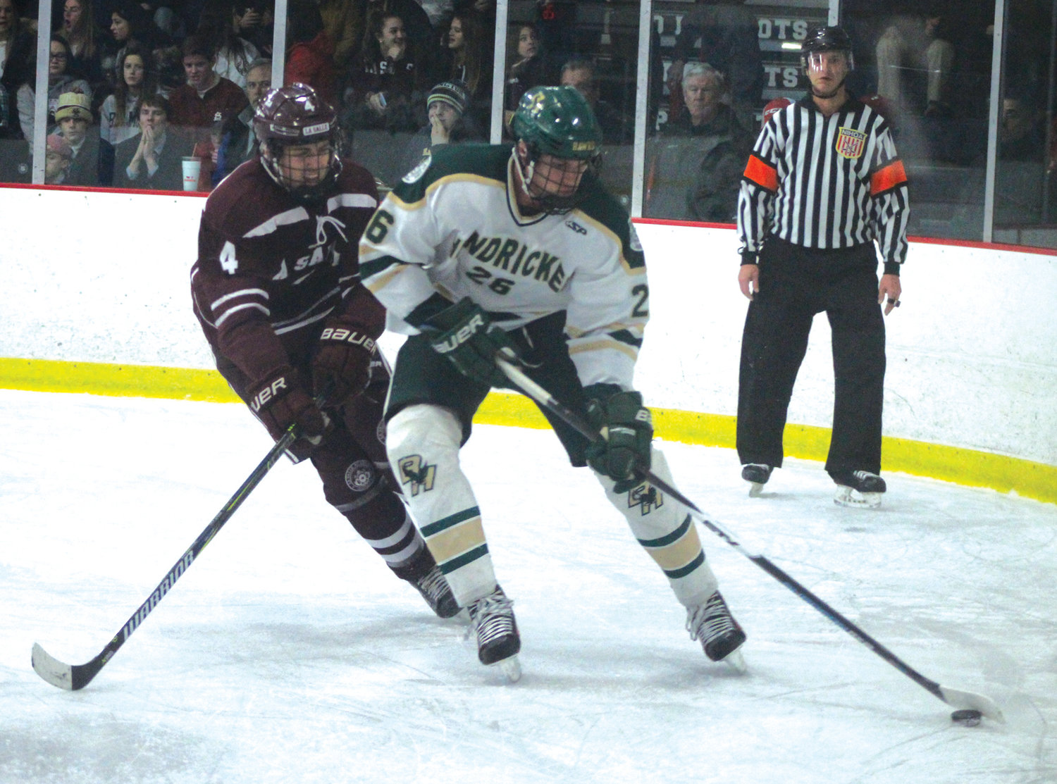 ALONG THE BOARDS: Bishop Hendricken's Jonathan Barker works against a La Salle forward to clear the Hawks' zone on Friday night at the Thayer Arena. The two clubs battled to a 4-4 tie.