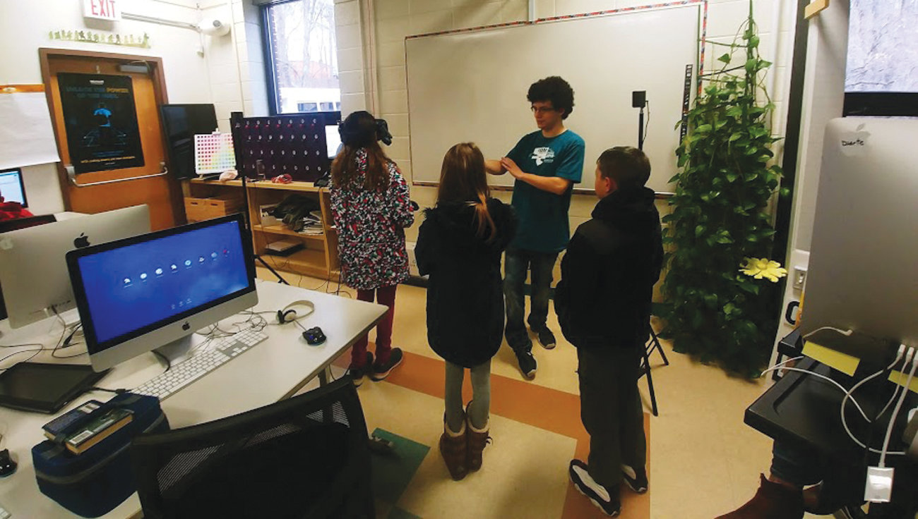VIRTUAL REALITY: In the Interactive Digital Media pathways program, visiting students had the opportunity to use virtual reality goggles and create a dance party using their coding skills.