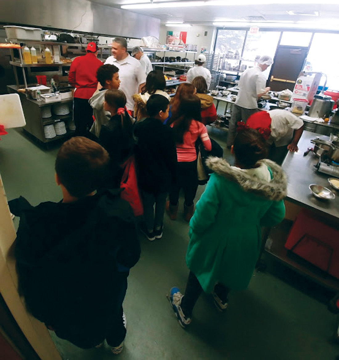 A REAL RESTAURANT: Elementary school students toured the Culinary Arts pathways kitchen area, where the high school students were busily preparing a delicious restaurant-quality lunch, as part of the Hour of Code event.