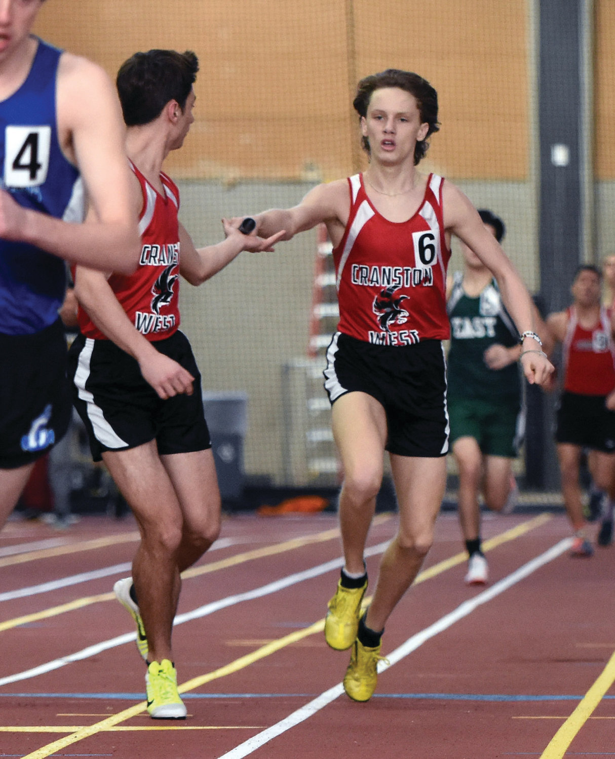 ON THE TRANSFER: Cranston West athletes compete in a relay at the Class Championships.