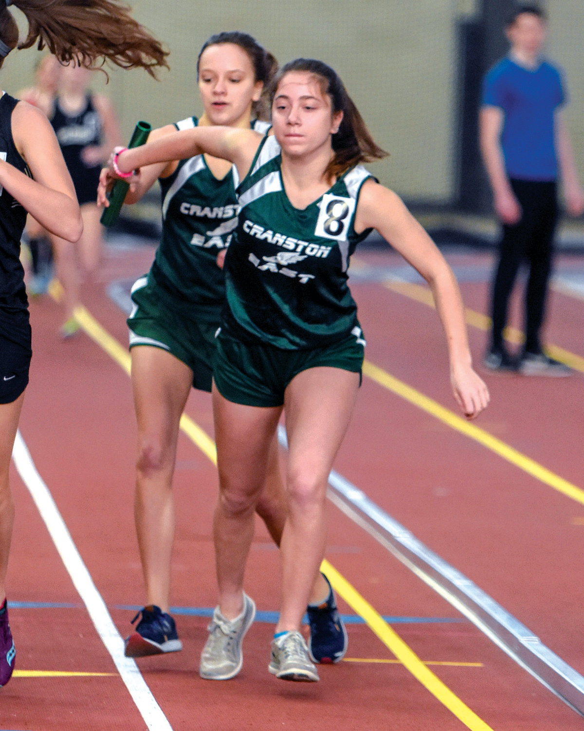 ON THE RIGHT TRACK: Cranston East's Michelle Diaz-Arajuo and Eva Caron work together during a relay for the Thunderbolts in the Class Championships last week in Providence.