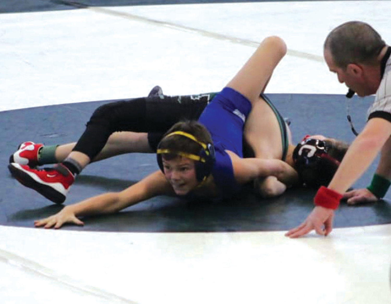 HITTING THE MAT: Vets' Seth McGrew, who won the state title at 70 pounds, works his way through a match at Ponaganset.