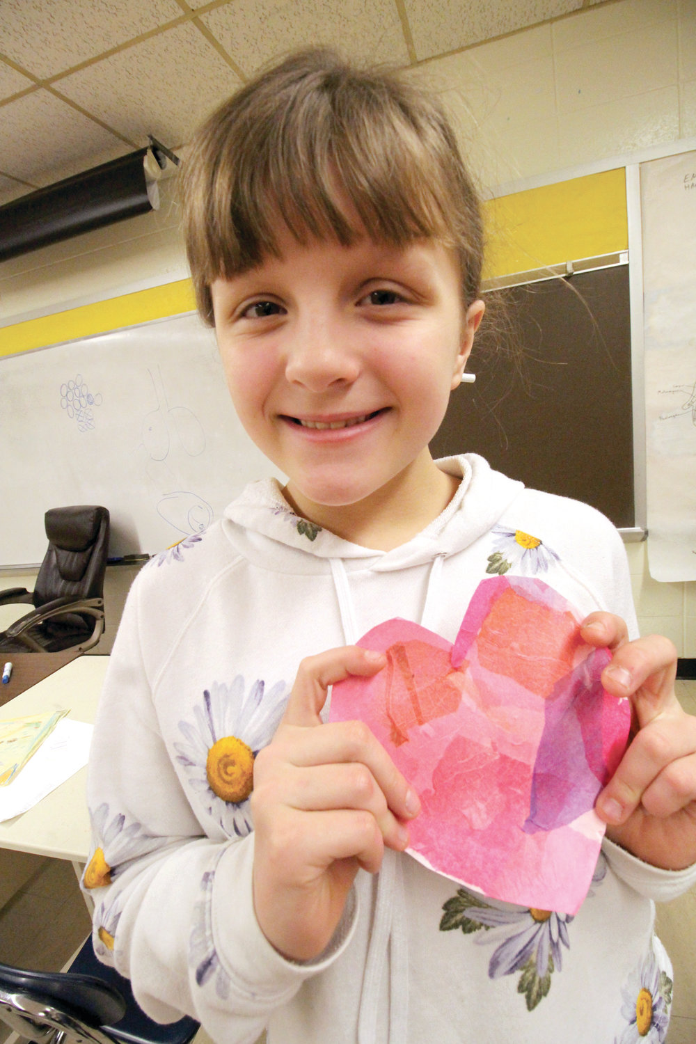 MAKING HEARTS: Art teacher Ashley Potter demonstrates how to make a heart to Jonathan Lopes and Logan Greenslade.