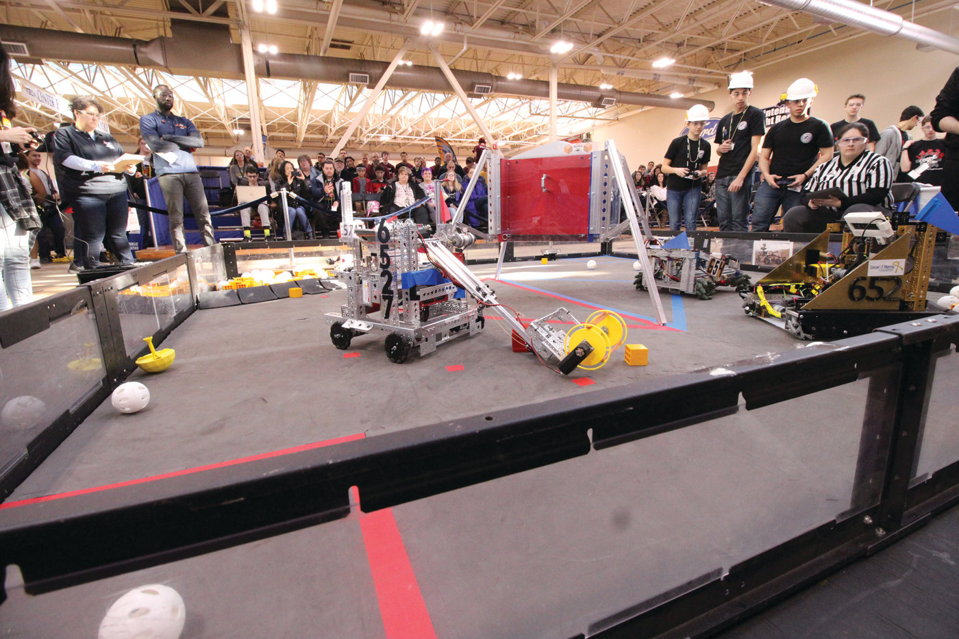 IN THE RING: Competing robots scramble to complete tasks and win points during Saturday's FIRST Tech Challenge held at the NEIT Center for Automotive Technology.