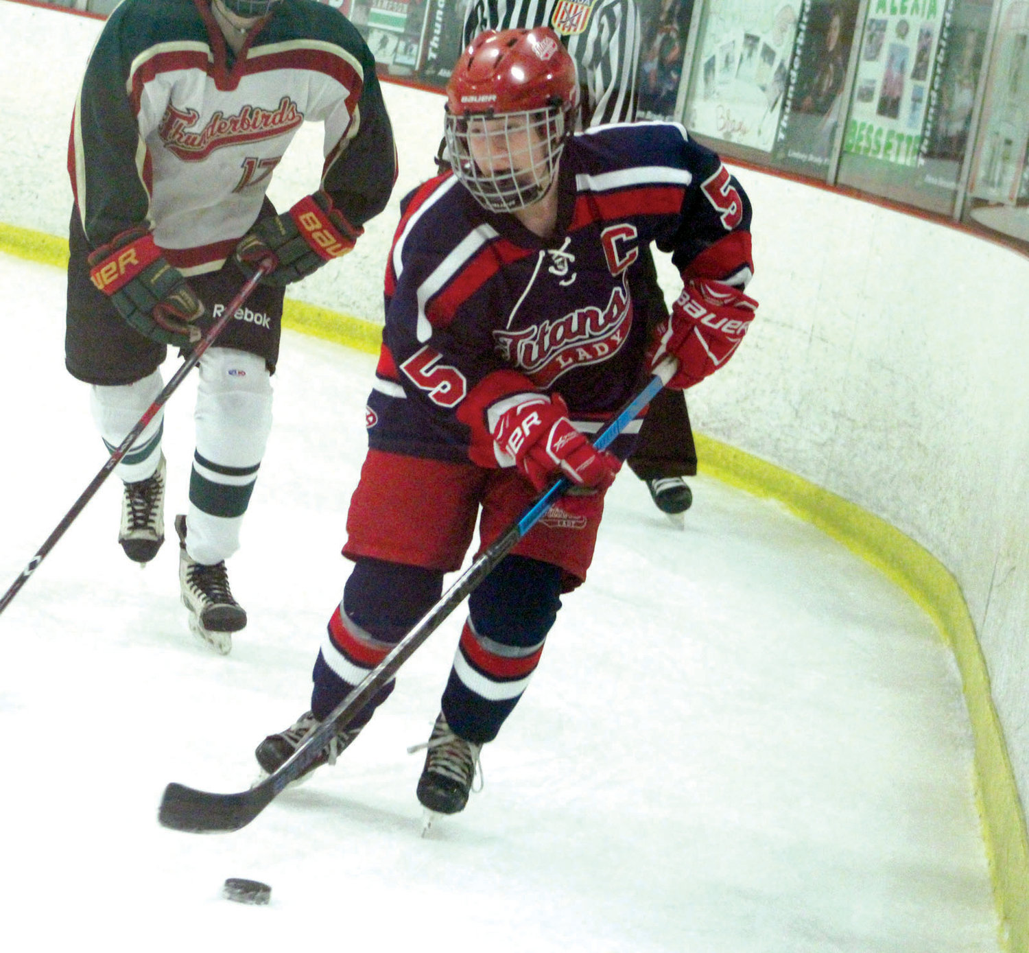 AROUND THE NET: Warwick's Nicole Procaccini carries the puck behind the net.