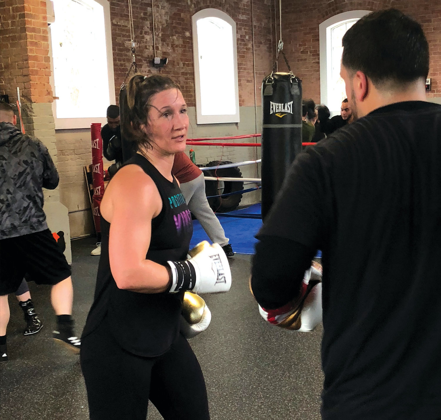"LEARNING THE ROPES: On the Ropes Boxing and Fitness co-owner Jaime ""Hurricane"" Clampitt Hayes works with a student during a class this week on site at 334 Knight Street in Warwick. Clampitt Hayes, the gym's lead boxing trainer, is a former WBFF fighter, who enjoyed a 10-year career in professional boxing, and looks forward to sharing her knowledge with the City of Warwick."
