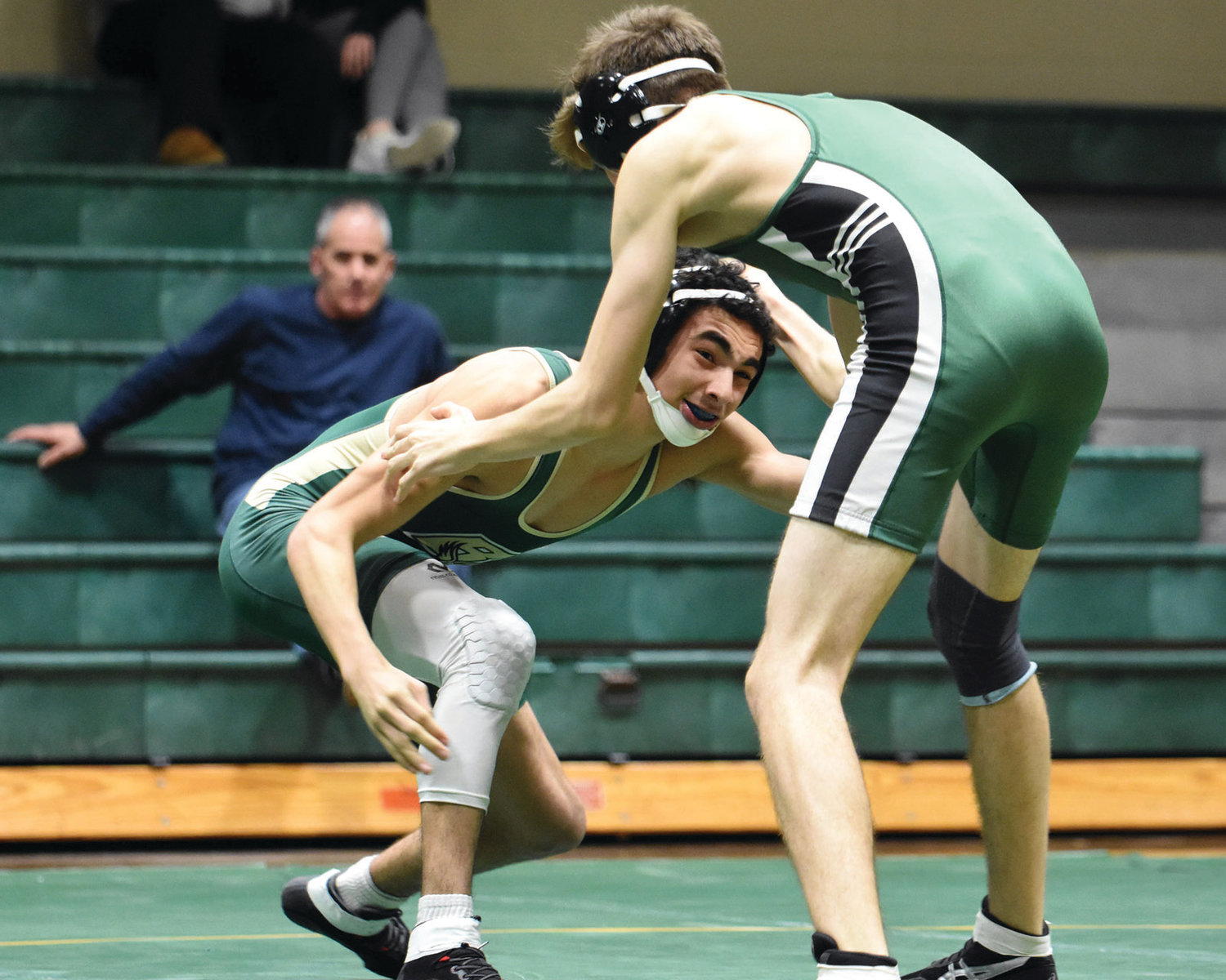 CLOSING THE DISTANCE: Bishop Hendricken's Isaiah Guerrero looks to clinch during a recent match.