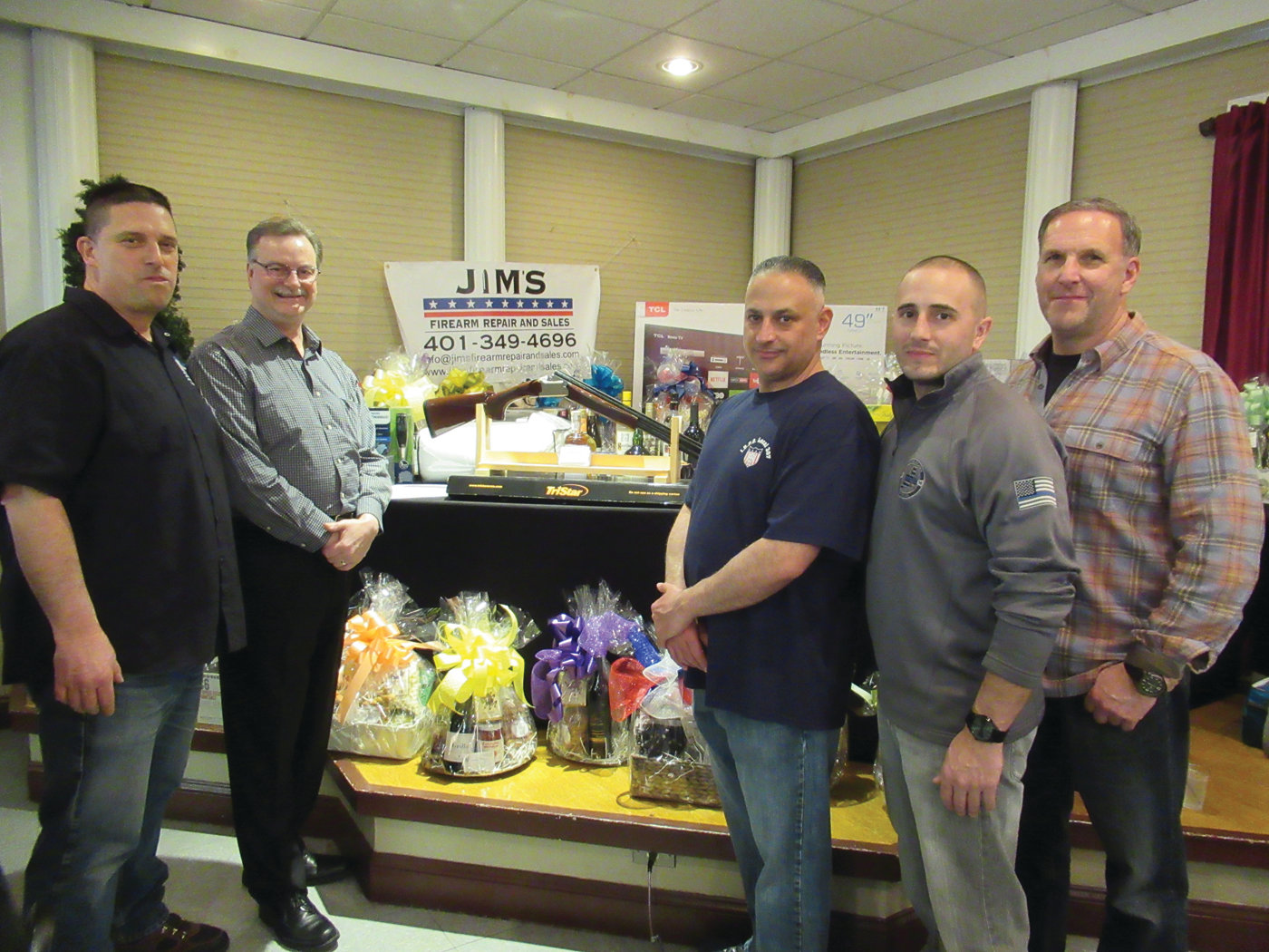 EVENT SPONSOR: Jim Connors, second from left, who owns and operates Jim's Firearms, sponsored the IBPO Local 307 venison dinner. He is joined by organizers Sgt. Joe Scichilone, patrolmen Mike Andreozzi and Arthur Petteruti and Detective Brian Loffredi.
