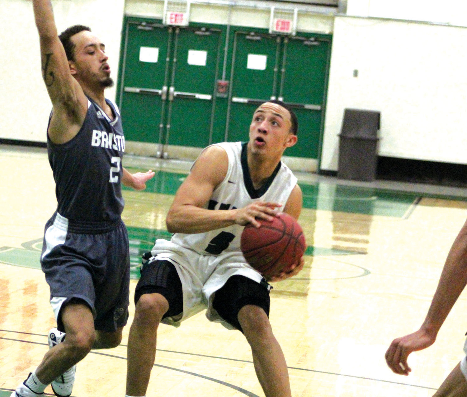 IN THE PAINT: CCRI's JC Santos works past a Bristol defender.