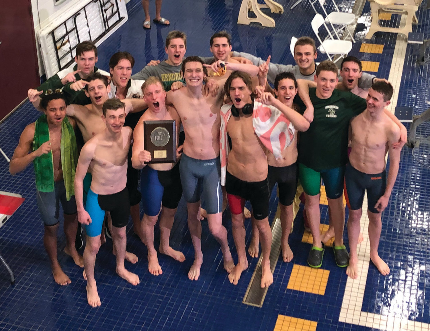 DIVISION CHAMPS: The Bishop Hendricken swimming team celebrates after winning the Division I Championship last weekend. The Hawks will now move on to this weekend's state championship meet, where they look to claim their 28th title in 29 years.