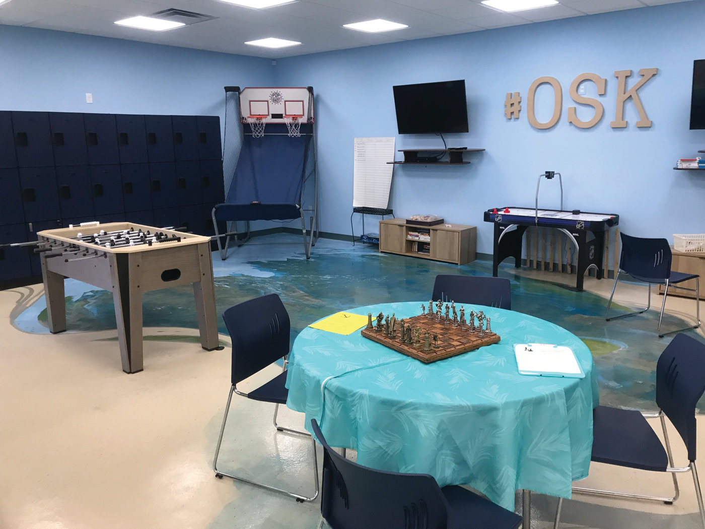 FUN ENVIRONMENT: The recreation area at Ocean State Kidz Club includes foosball, chess, a hoop shoot, air hockey and other games.