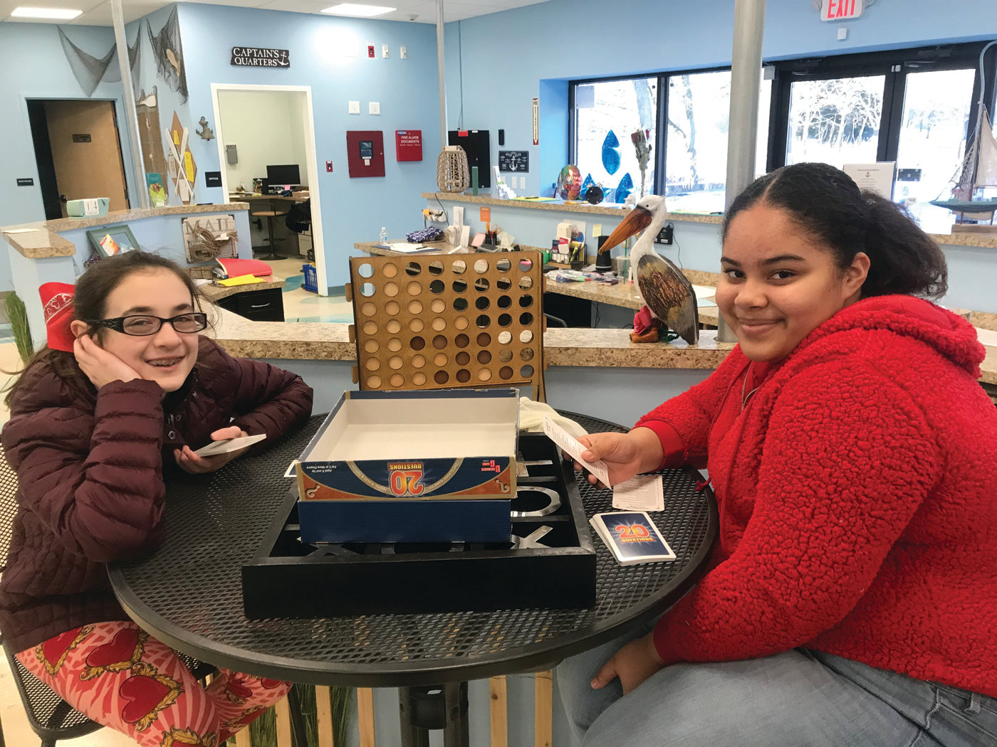 "FRIENDLY CONTEST: Mia Walters, left, and Jerrica Johnson, who have been friends for several years, get ready for a game of ""20 Questions"" at the Ocean State Kidz Club on Feb. 14."