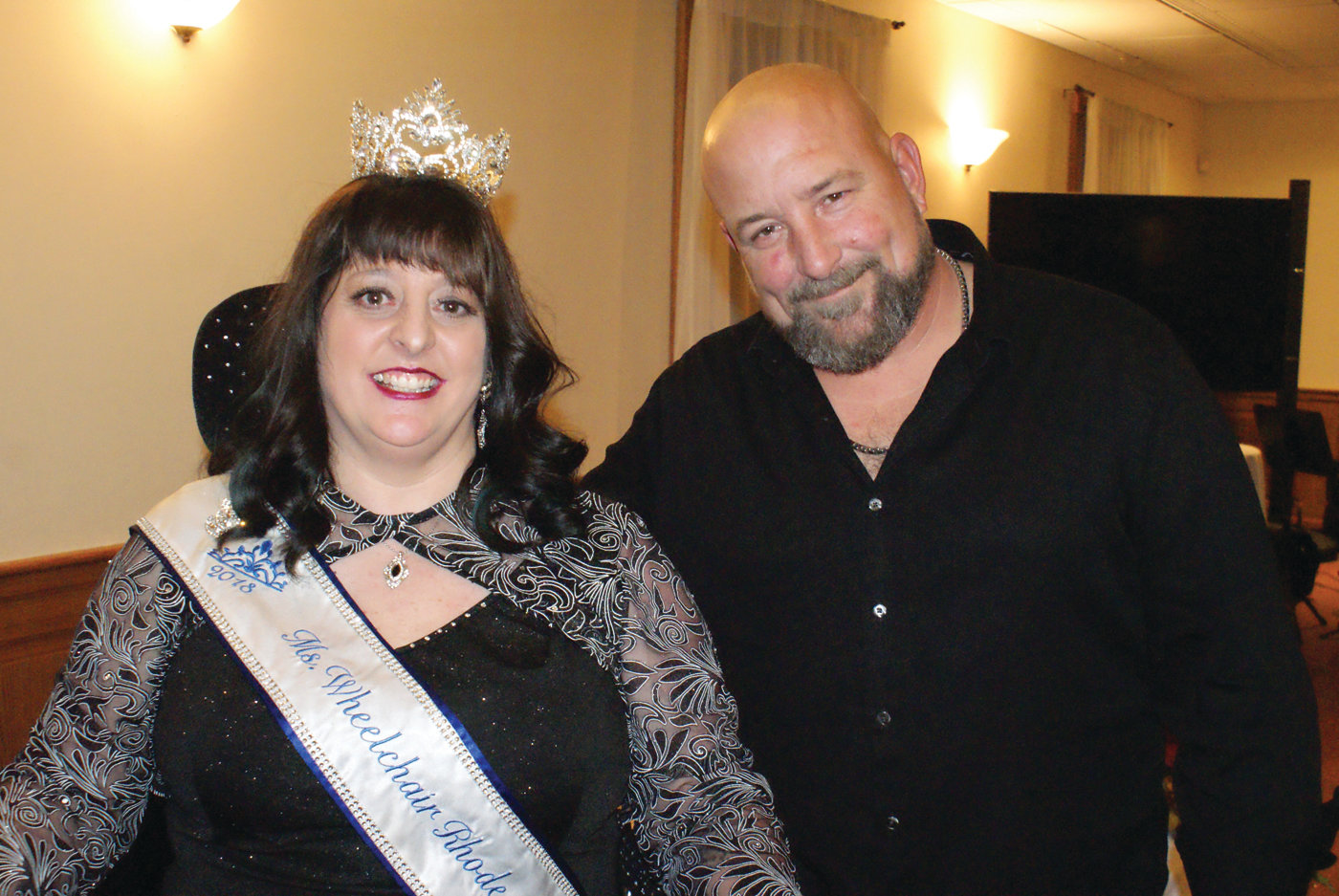 TEAMWORK: Ms. Wheelchair RI 2018 Tina Guenette Pedersen is pictured with Jason Brady, founder and CEO of Northern Command Studios. He served as the emcee for this year's event.