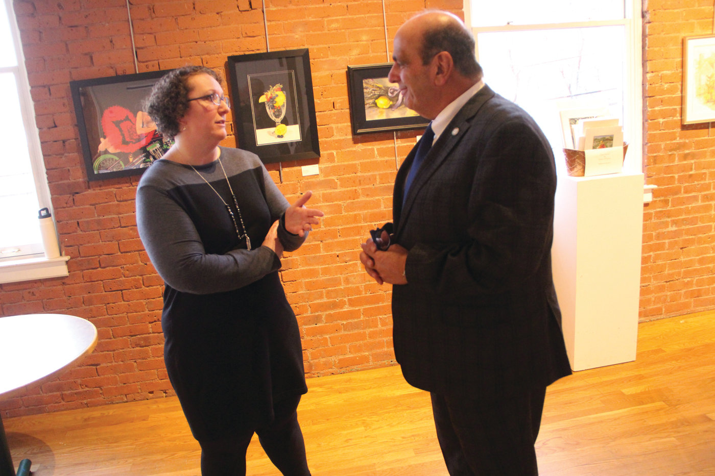 STATING HIS POSITION: Mayor Joseph Solomon talked with Stephany Hessler, president of the Warwick Center for the Arts, Wednesday. He told her he is not forcing the center from the armory, which he would like to use for city offices, but they can stay if they pay rent.