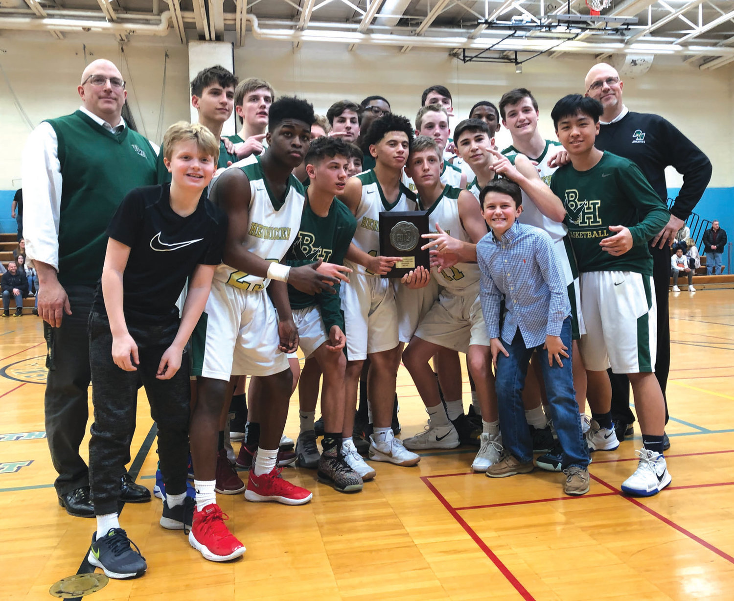 STATE CHAMPS: The Bishop Hendricken freshman basketball team celebrates its state championship win.