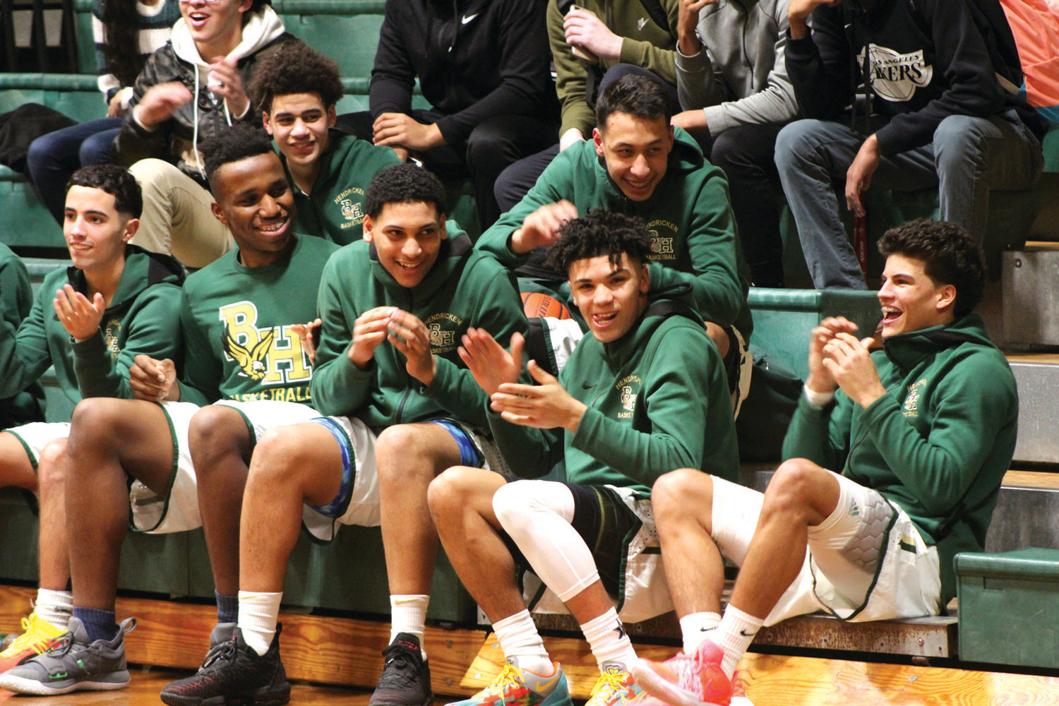 READY FOR BATTLE: Members of the Bishop Hendricken basketball team celebrate during the team's senior night last week.