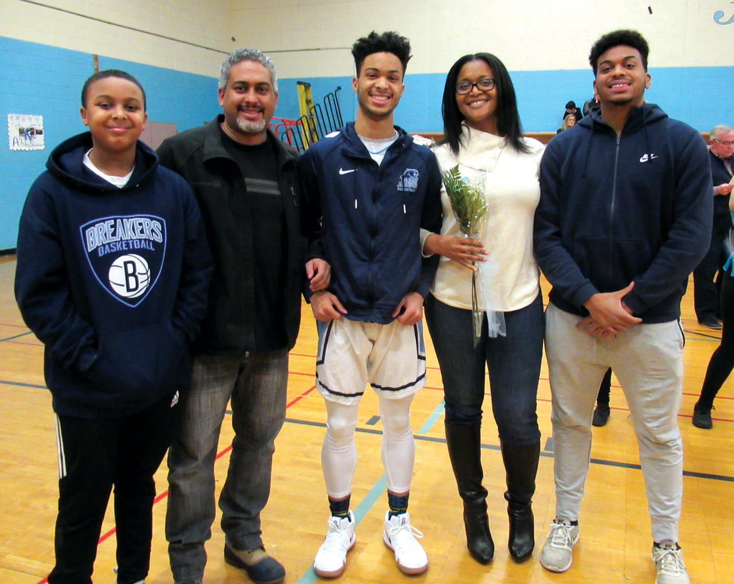 NATE'S NICHE: JHS senior Nate Vazquez is joined by his parents Tayna and Aris Vasquez and brothers Nas and NeAri during Tuesday's Senior Night.