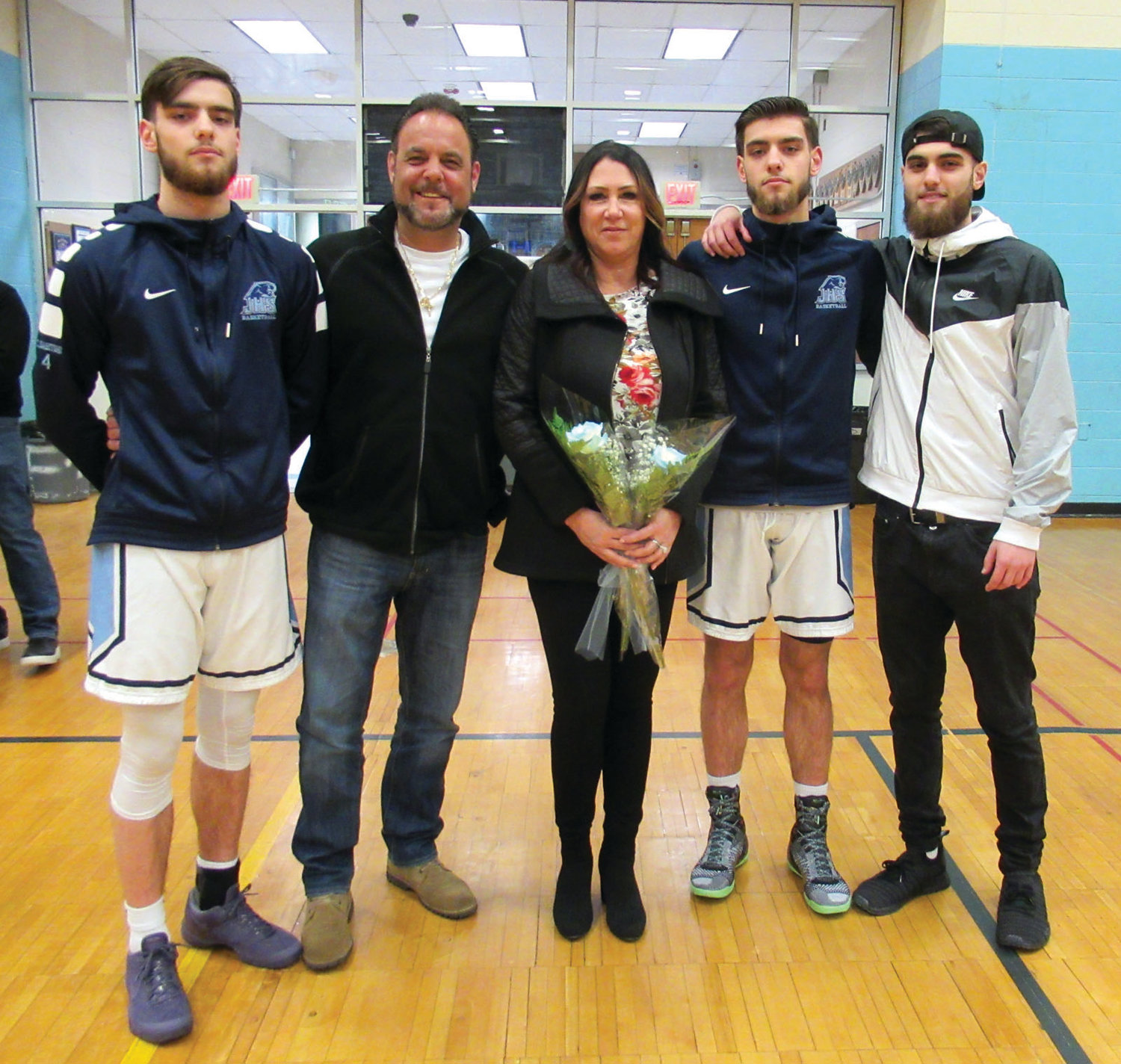 PROUD PARENTS: Mike and Joyce Sabitoni enjoy a lighter moment during Senior Night with their twin sons Cameron and Mike Sabitoni and son Michael Sabitoni.