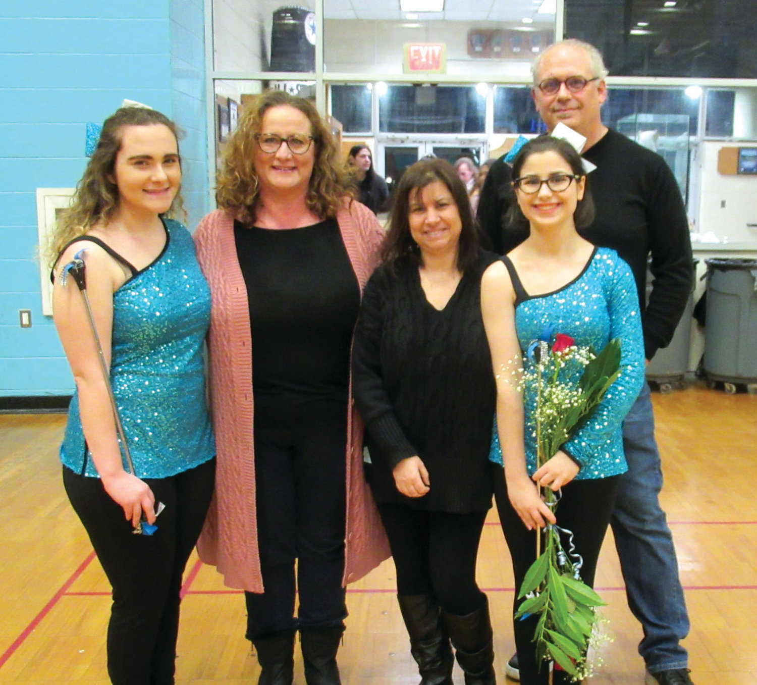 SUPPORT STAFF: The JHS marching Panther Band's senior majorettes – Jaihrie Mari Conti  and Cheryl Conti – were honored along with their parents Oviette DiLorenzo, Jaihrie Mari and Dominic Conti during Tuesday's Senior Night.