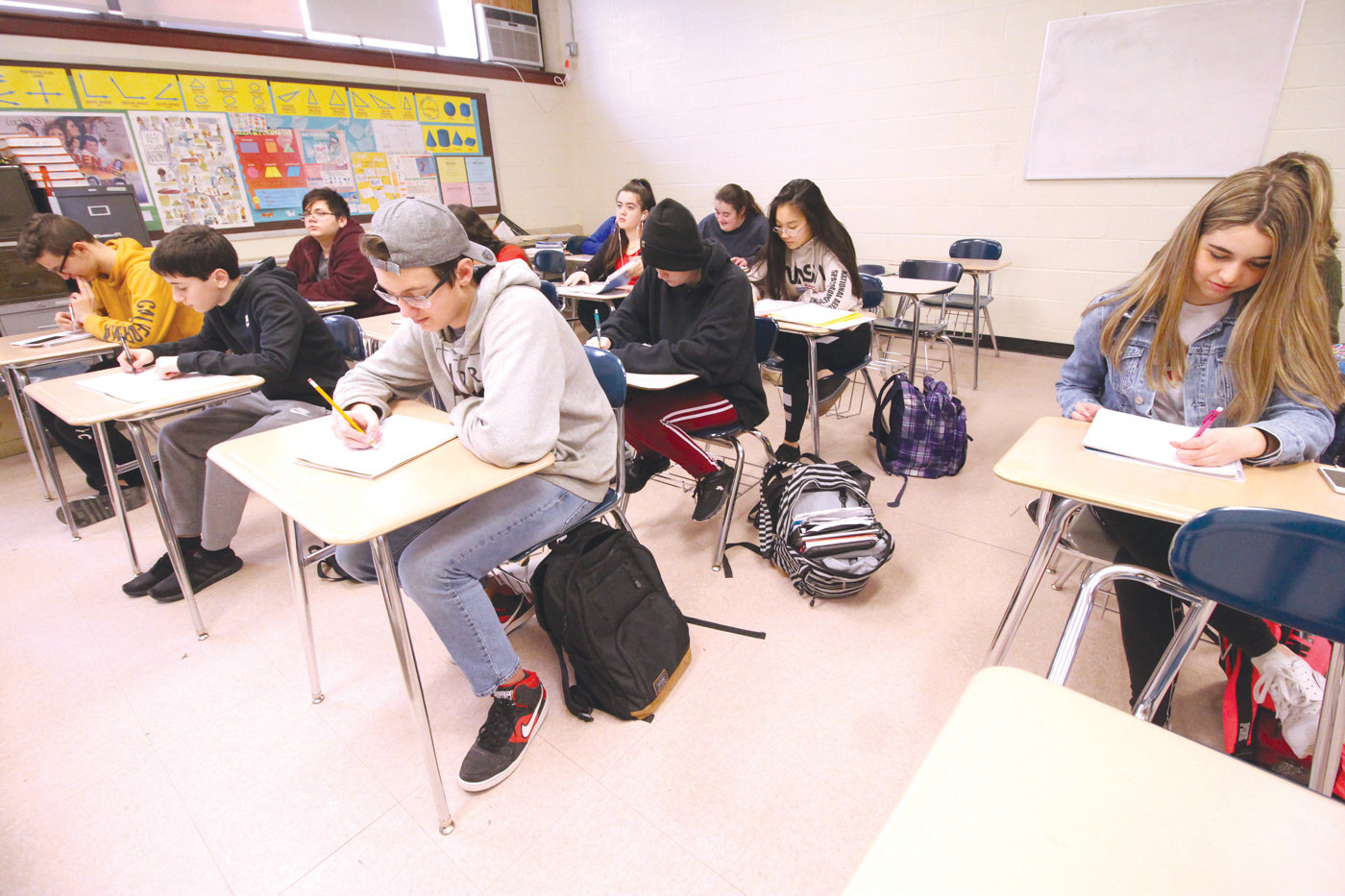 THEY KNOW THE DRILL: In the conventional classroom - this one is at Pilgrim High School in Warwick - students, sitting in rows, face the teacher in the front of the room.