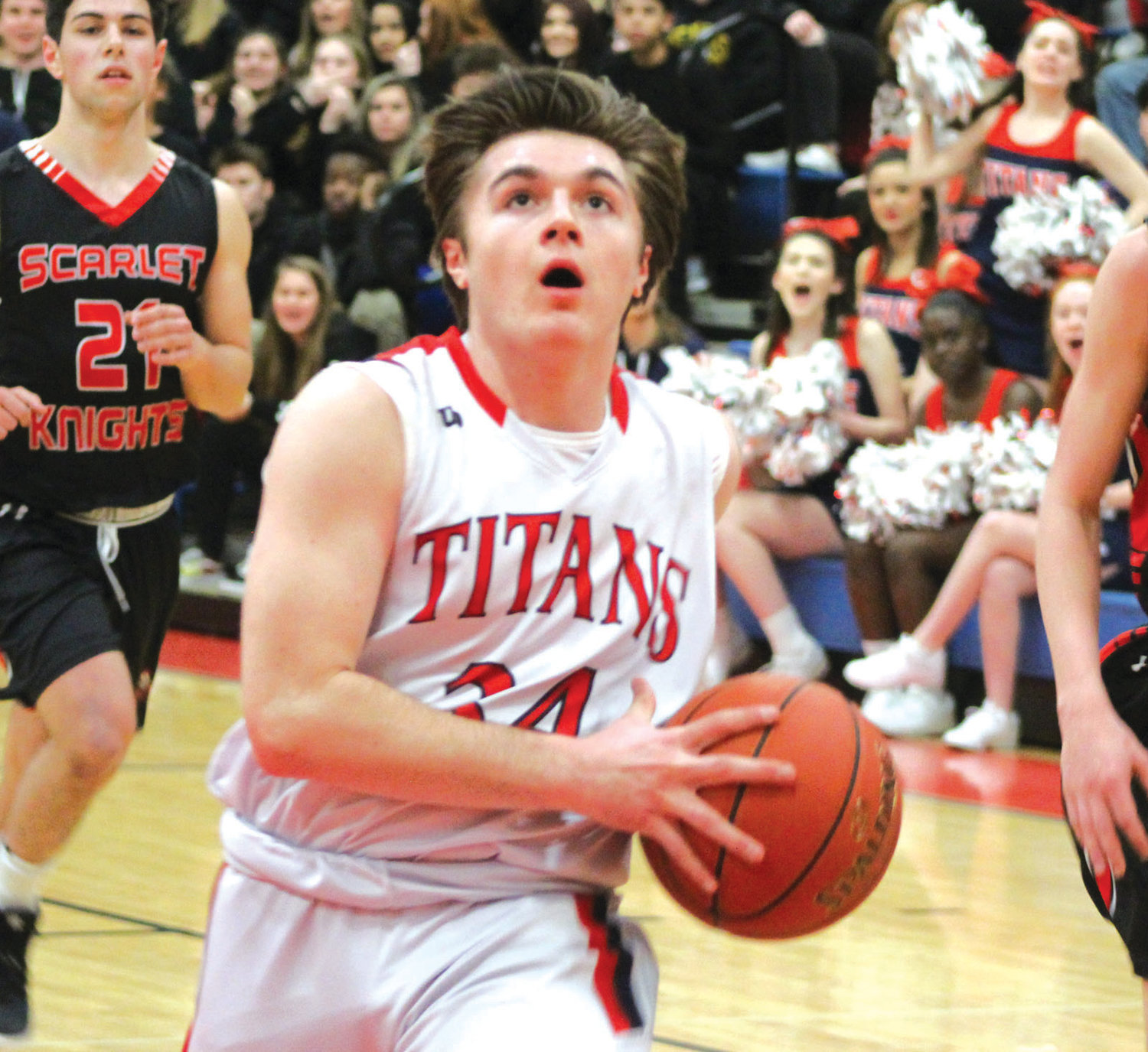 PLAYOFF BASKETBALL: Toll Gate's Austin Noon drives to the basket.