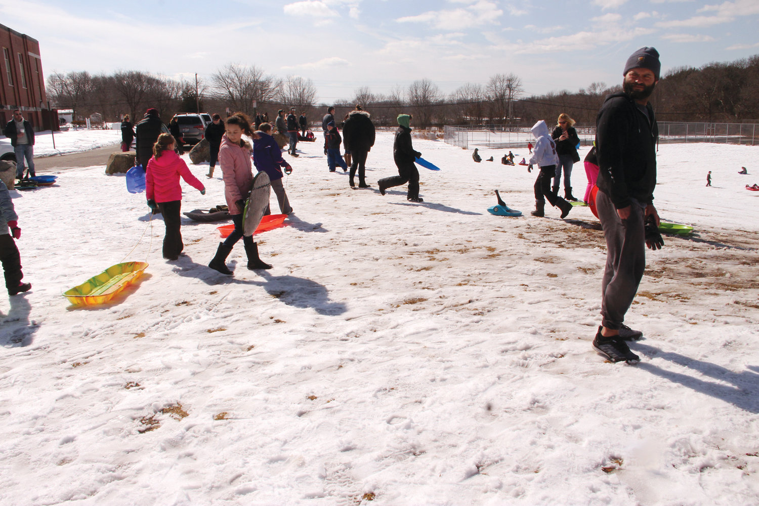 ALPS OF LONGMEADOW: The Gorton slope was busy Saturday as ideal weather made for some great sledding.