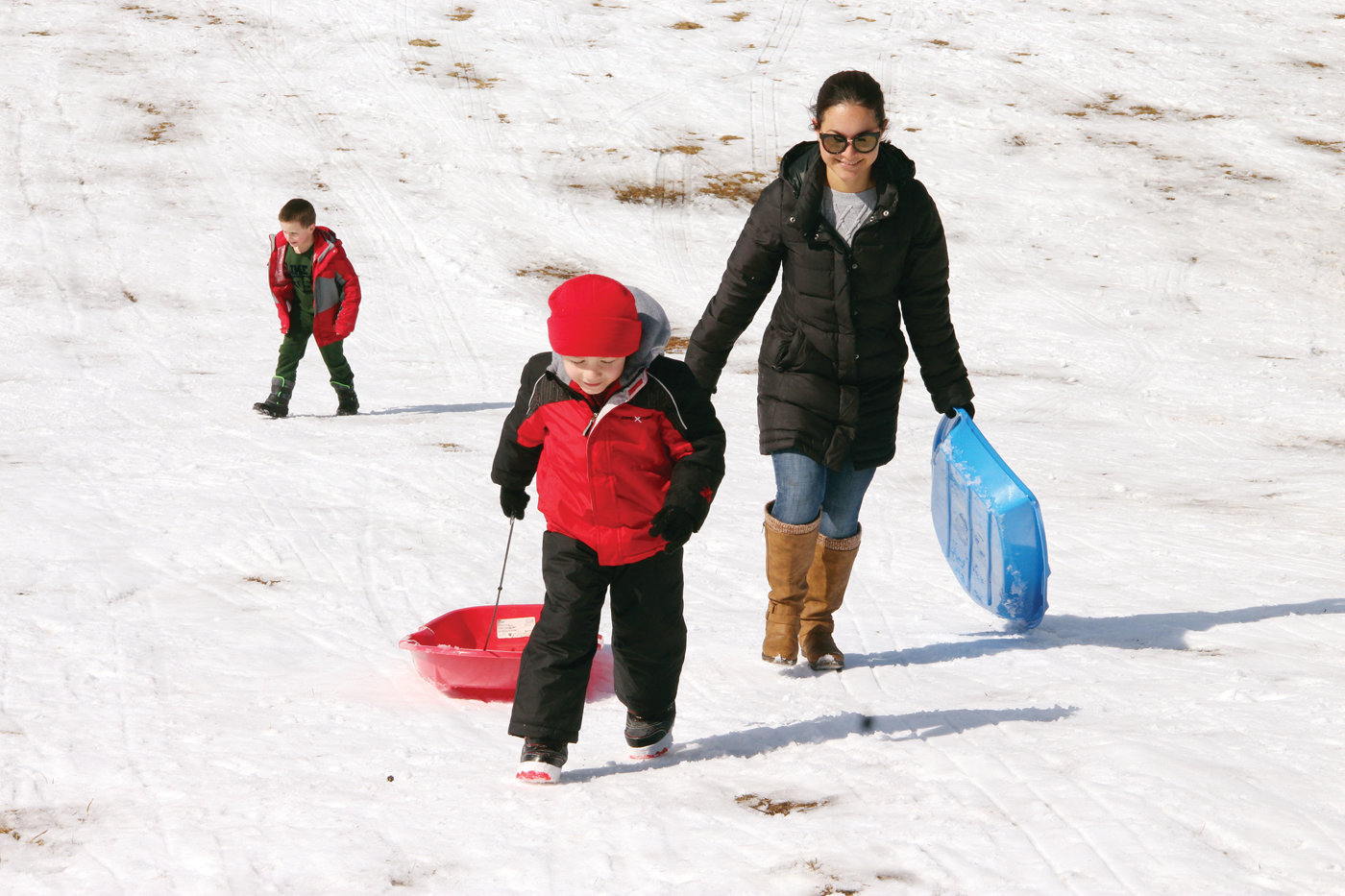 THE CLIMB BACK UP: Claudia Pacheco and her son Ethan head up the hill for another run.