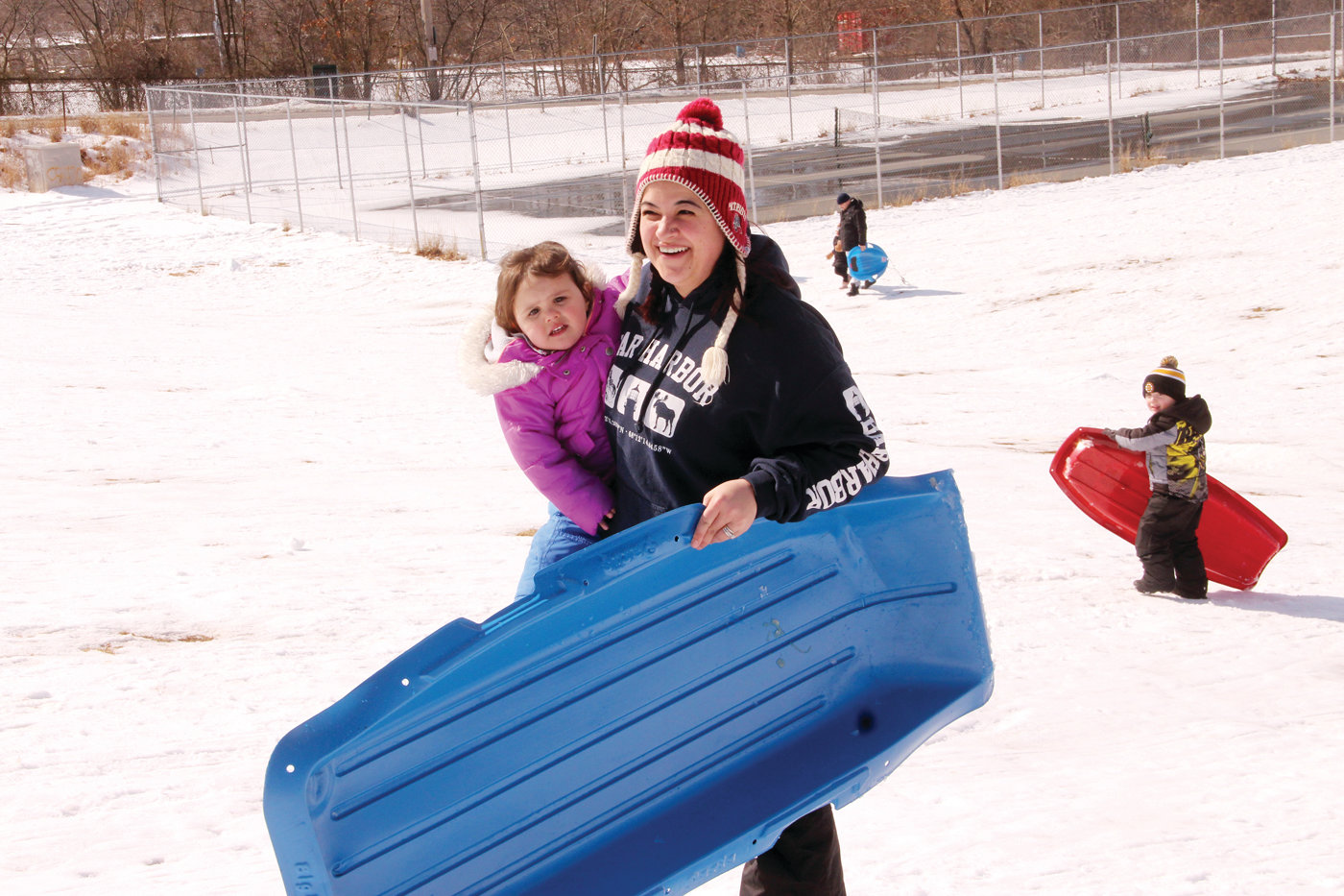 MOM GETS TO CARRY: Lindsay Murray carried both the sled and her daughter Karoline.