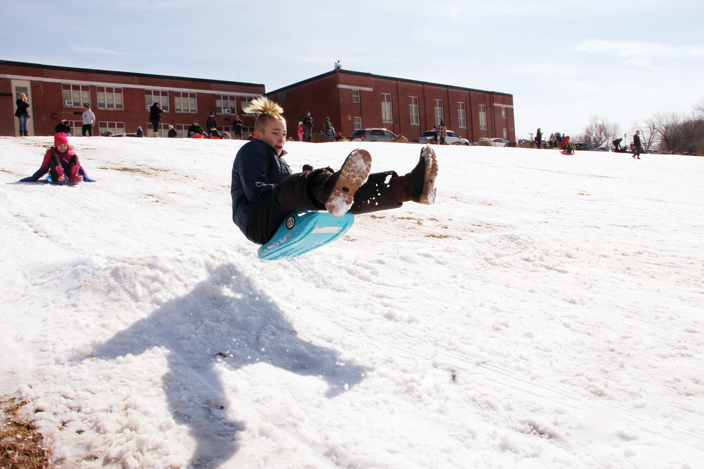 FLYING THROUGH WINTER: One of the scores who found sledding conditions ideal Sunday at the former Gorton Junior High School takes to the air from one of several bumps kids built for that purpose.