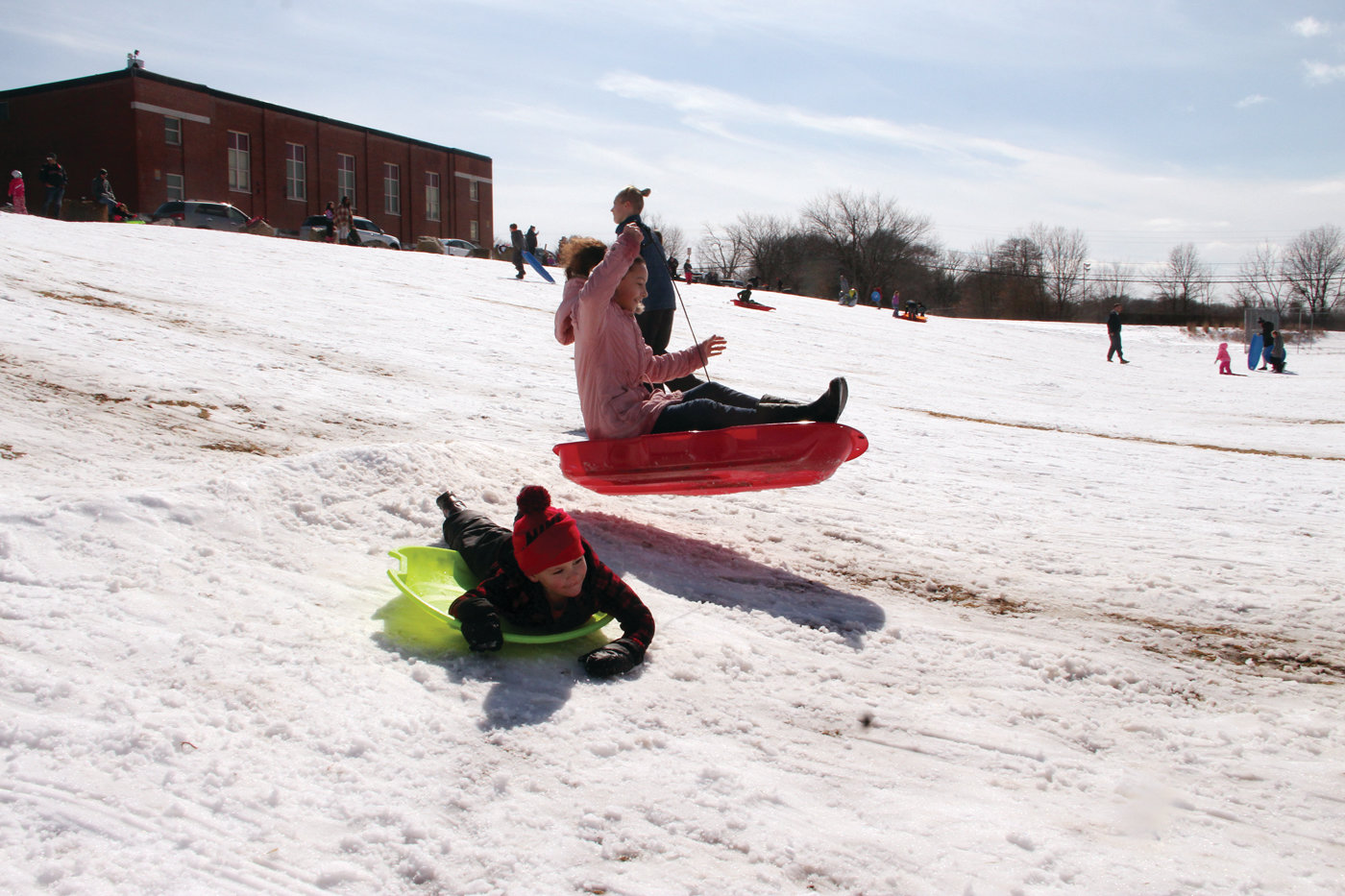 Savannah Pacheco took to the air and came down without losing her sled.