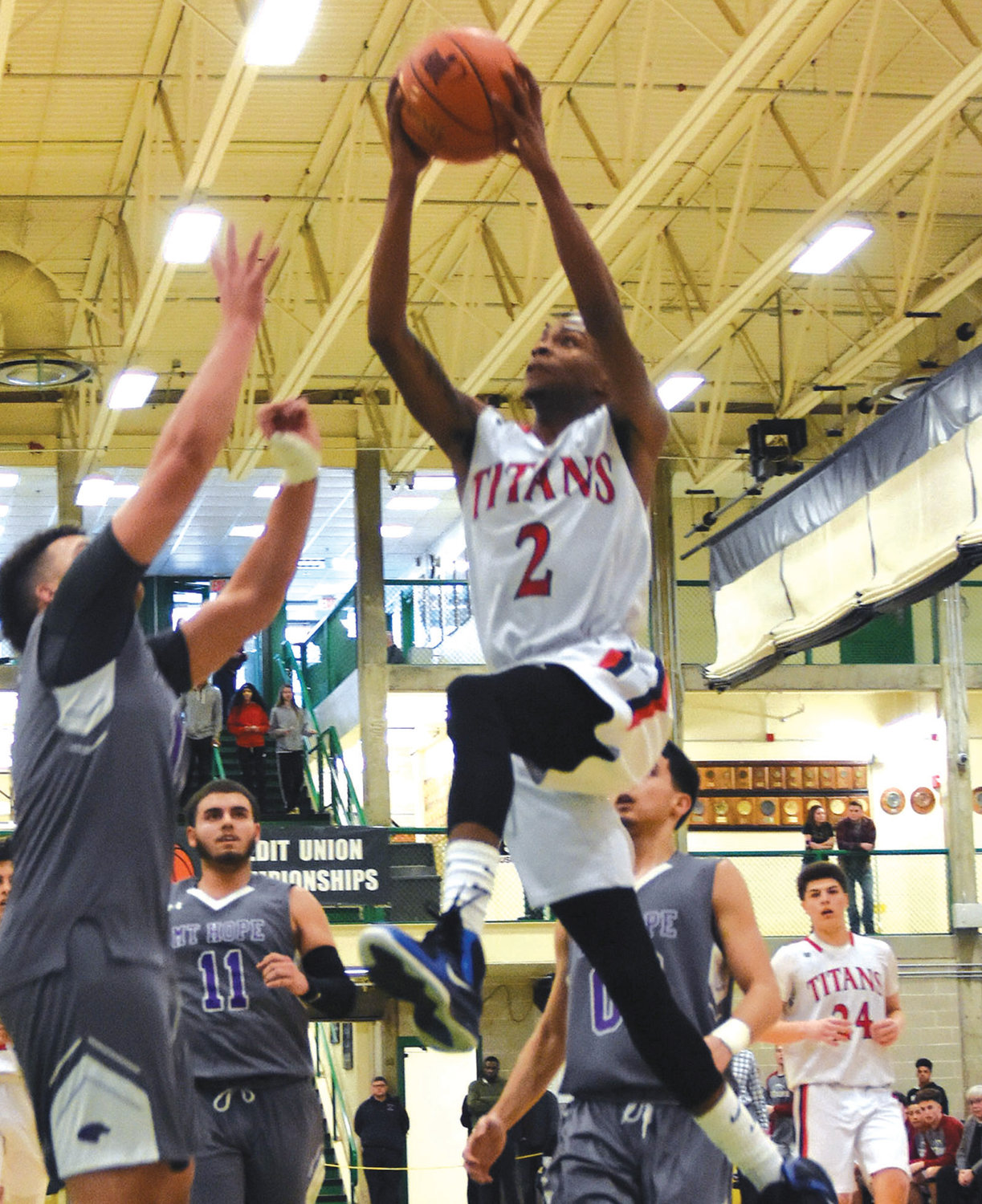 HANG TIME: Toll Gate's Kavi Simpson gets some air in the D3 title game against Mt. Hope.