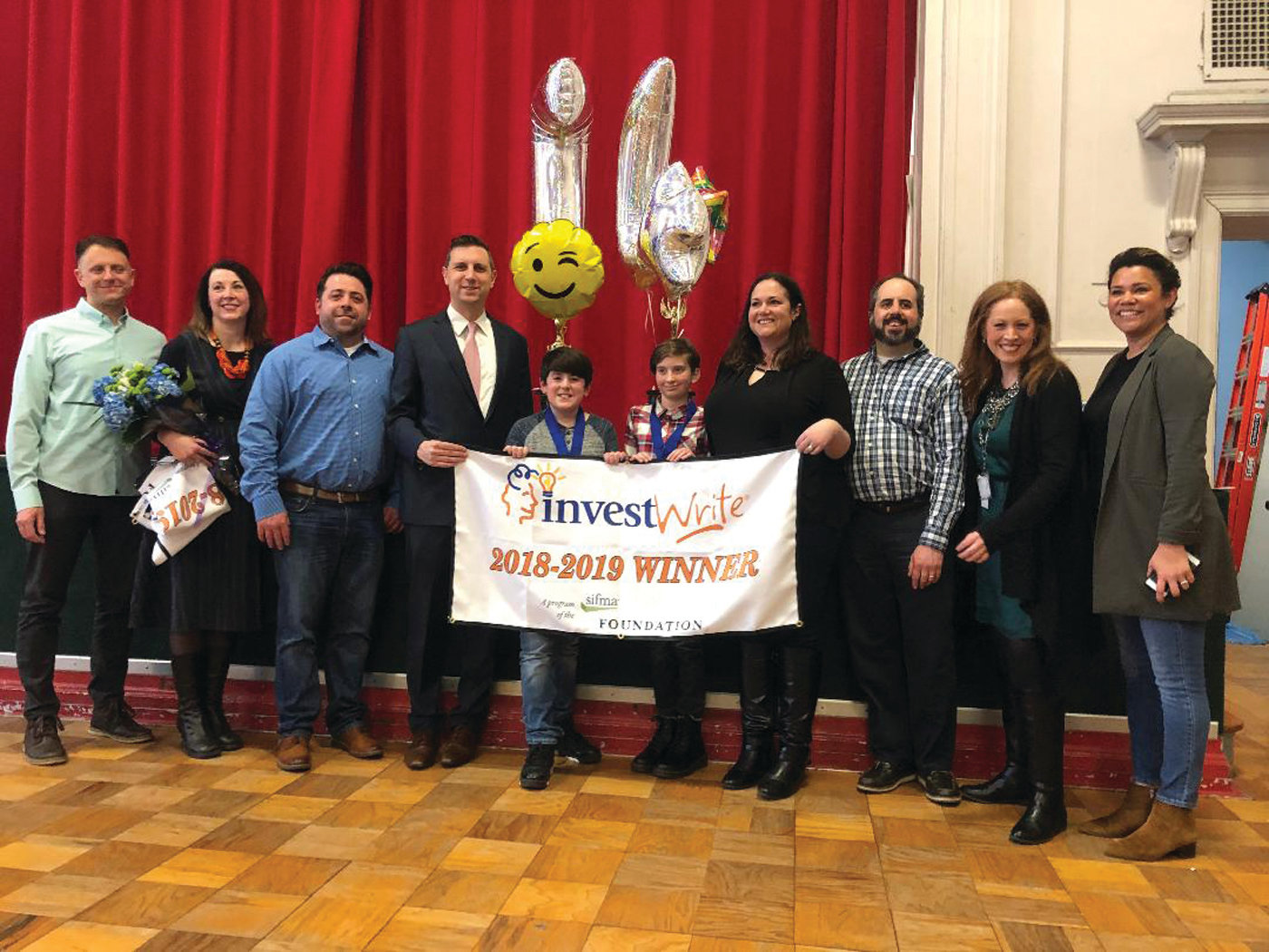 SAVVY INVESTORS: There were two InvestWrite essay contest winners from Rhodes Elementary School this year. Fifth-grade students Livia Leary and James Conway and their teacher, James Gemma, were all honored during a ceremony that has become an annual tradition at Rhodes.