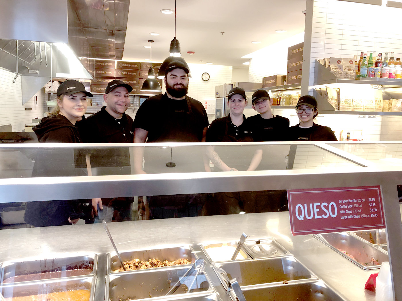 FAMILY ENVIRONMENT: Kenny took a group shot with some members of his Chipotle family (from left) Alyssa, Jason, Rachel, Shyanna and Yolymar.