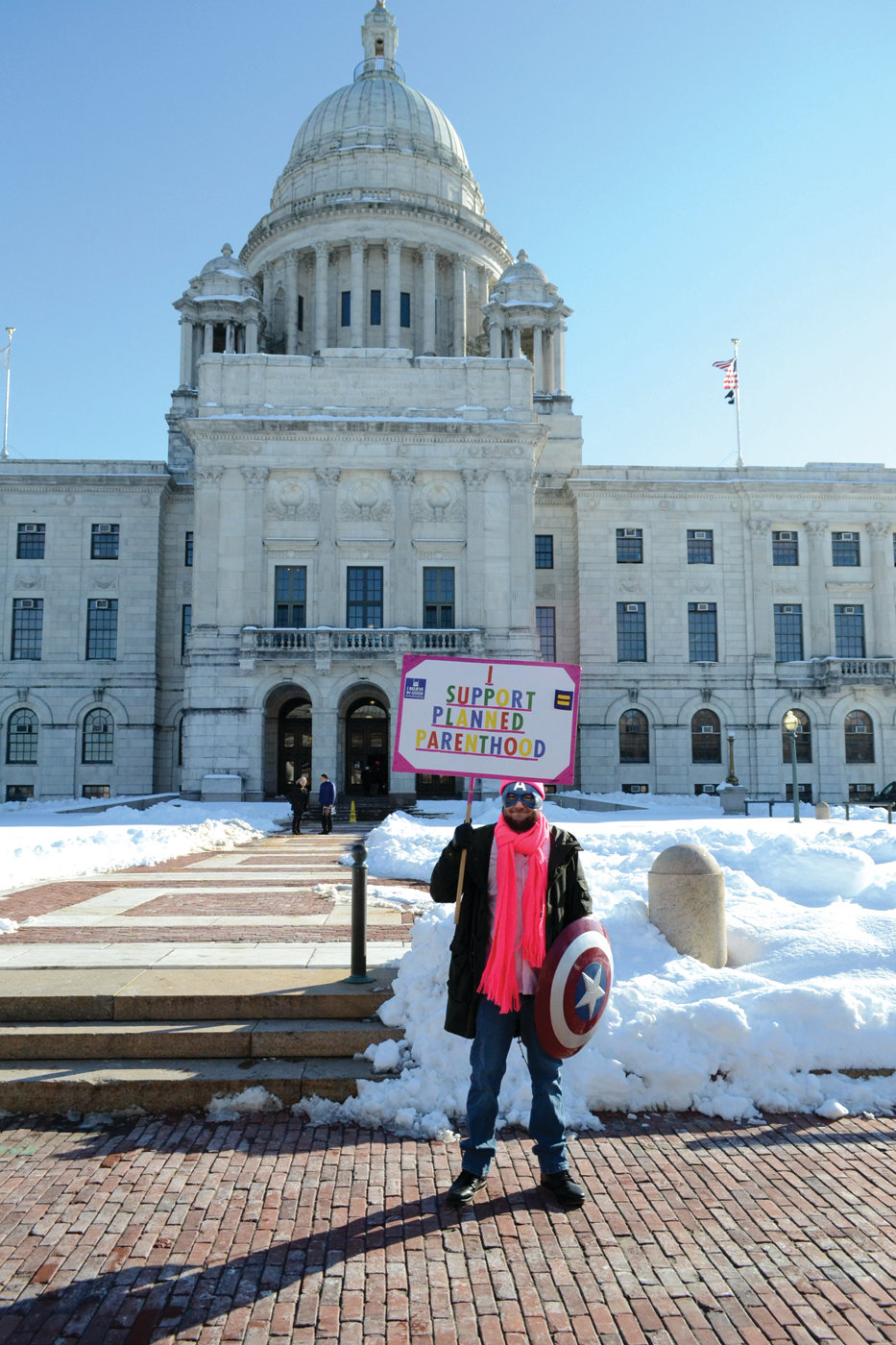 PROTECTING CHOICE: Joe Burgio, a Warwick resident, took up a spot in front of the State House visitor's entrance donning Captain America gear and proclaiming his support of pro-choice legislation and decrying those who seek to shut the bill down.
