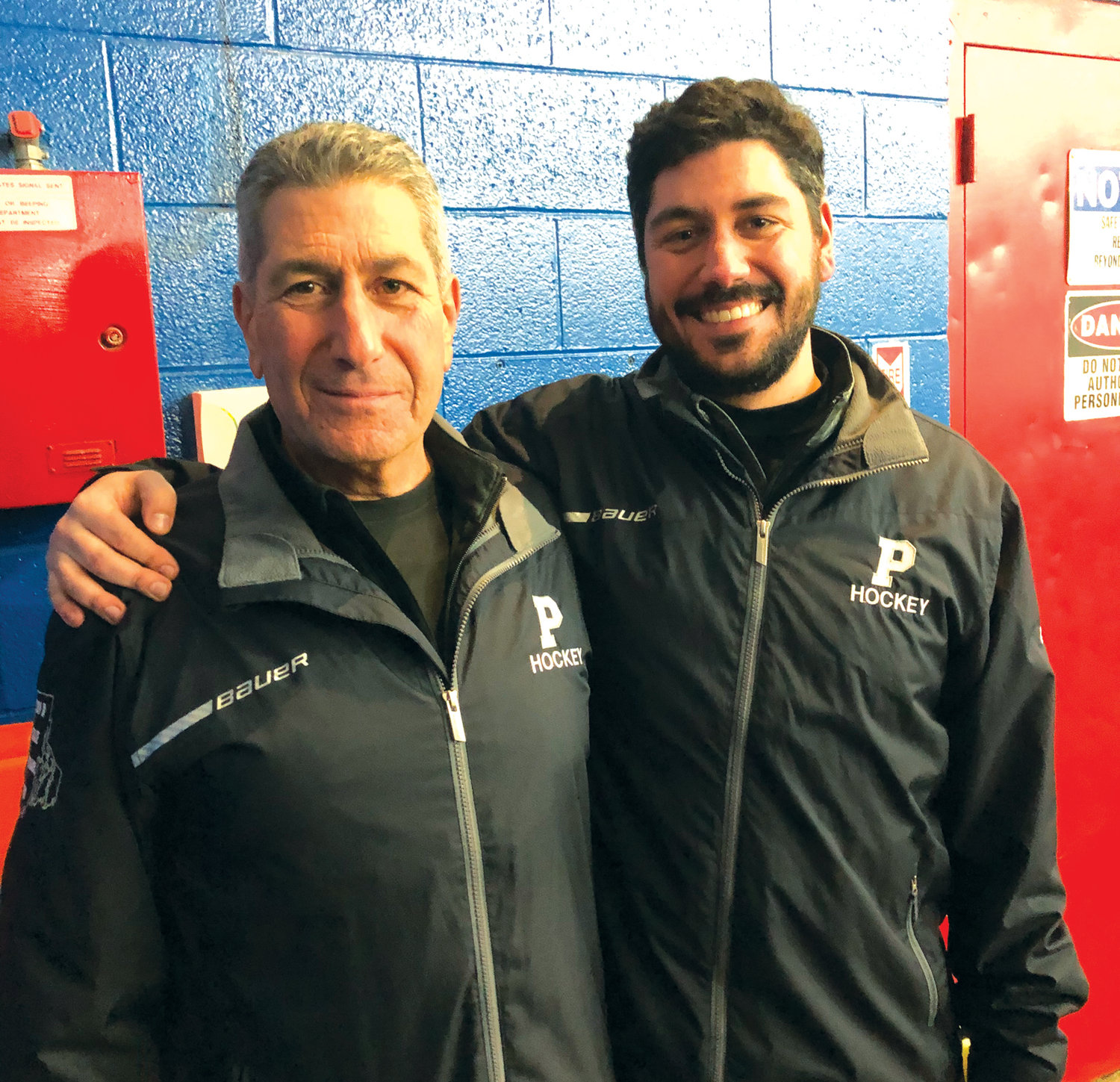 Pilgrim head coach Mike Boyajian Jr. (right) joins his father and assistant coach Mike Boyajian Sr. (left) after securing their place in the Division III State Championship on Tuesday. The pair became just the second father-son duo in Rhode Island to ever reach three consecutive state finals, joining Mount St. Charles' Bill and David Belisle. The Pats will take on the West Warwick/Exeter-West Greenwich co-op this weekend, with Game 1 on Friday night.